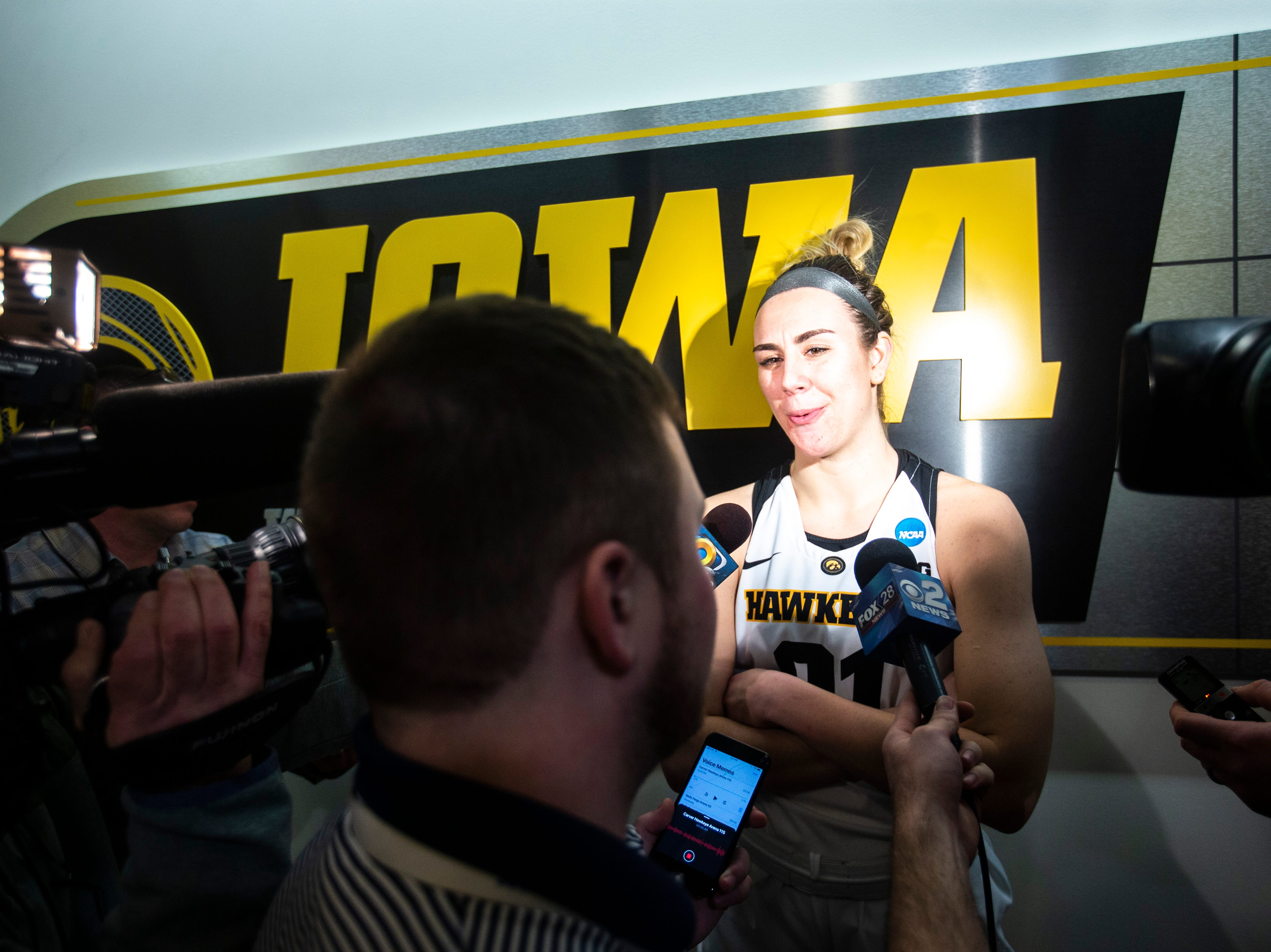 Iowa forward Hannah Stewart (21) talks with reporters after a NCAA women's basketball tournament second-round game, Sunday, March 24, 2019, at Carver-Hawkeye Arena in Iowa City, Iowa.
