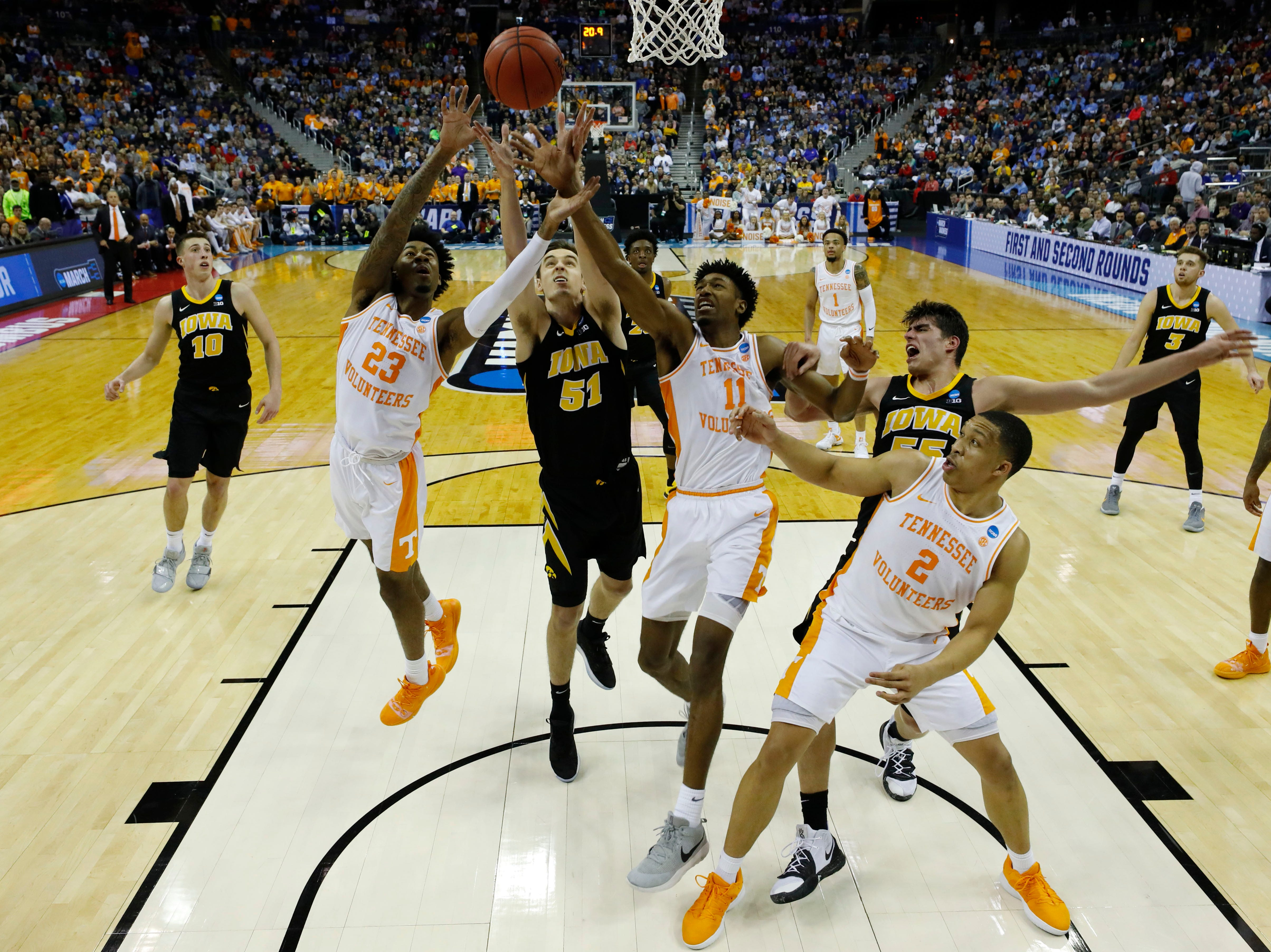 Tennessee Volunteers guard Jordan Bowden (23) and forward Kyle Alexander (11) battle for a rebounded ball with Iowa Hawkeyes forward Nicholas Baer (51) in overtime in the second round of the 2019 NCAA Tournament at Nationwide Arena.