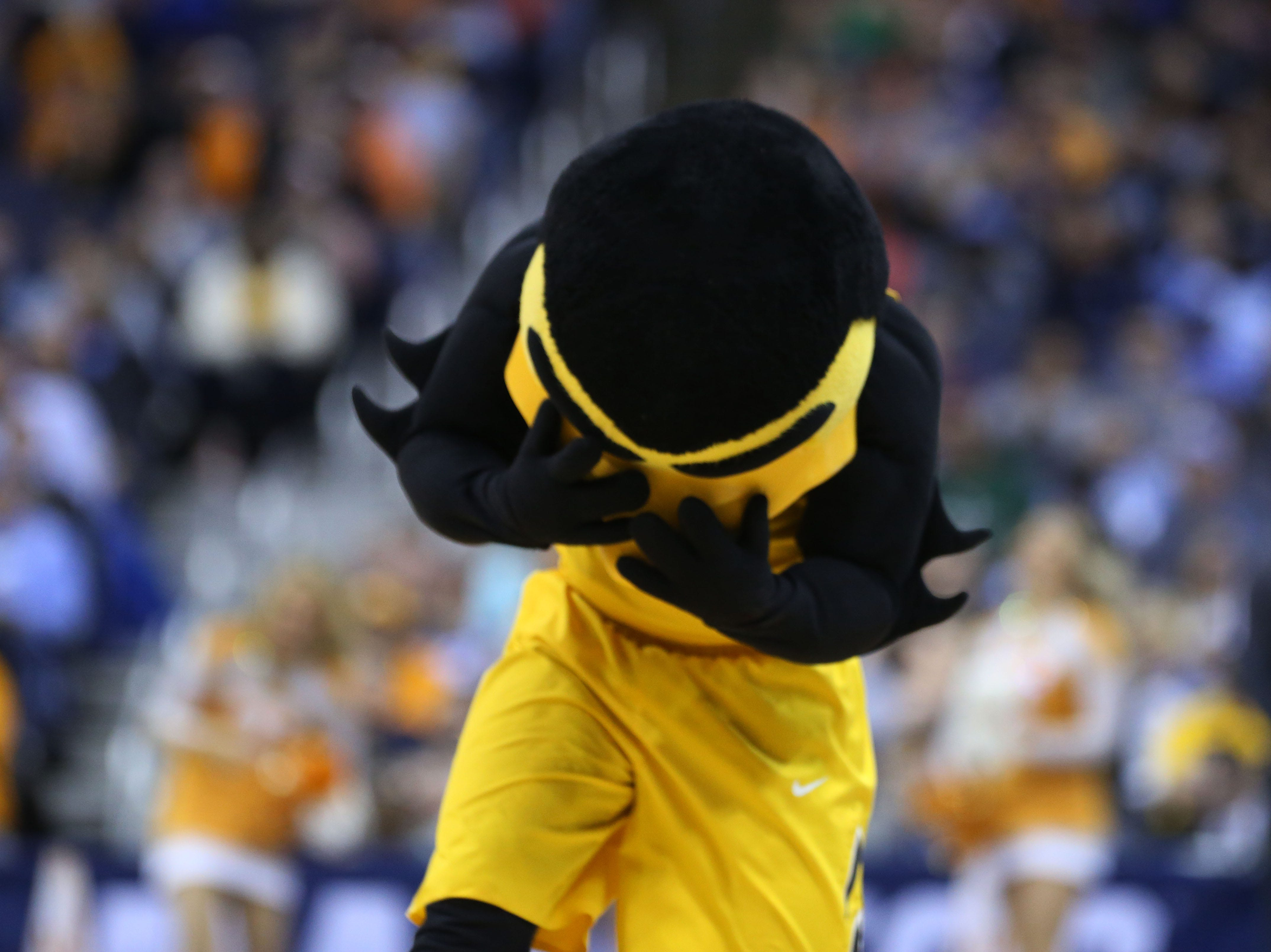 Iowa Hawkeyes mascot Herky the Hawk reacts to a play in the first half against the Tennessee Volunteers in the second round of the 2019 NCAA Tournament at Nationwide Arena.