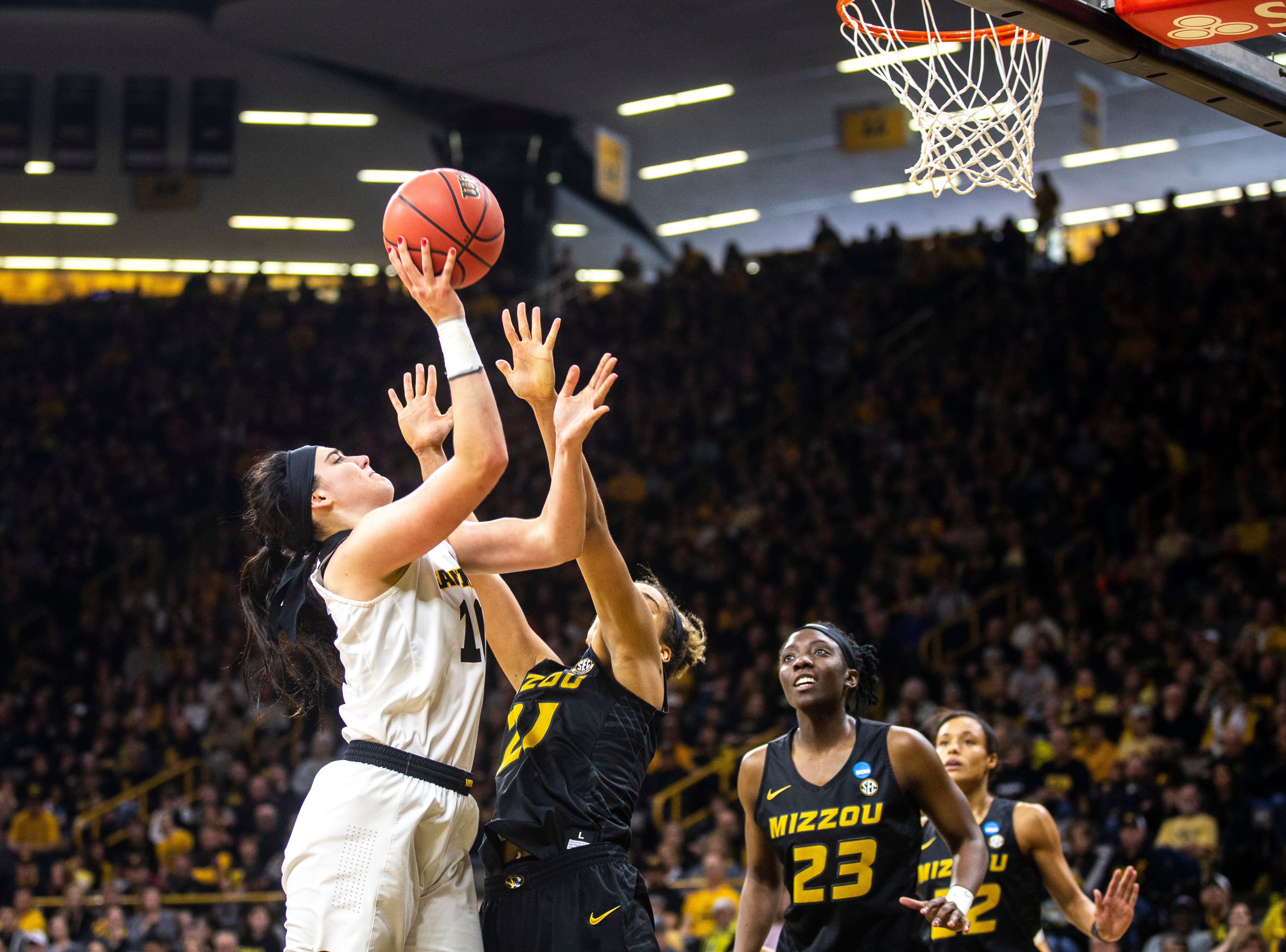 Iowa center Megan Gustafson (10) drives to the basket against Missouri forward Cierra Porter (21) during a NCAA women's basketball tournament second-round game, Sunday, March 24, 2019, at Carver-Hawkeye Arena in Iowa City, Iowa.