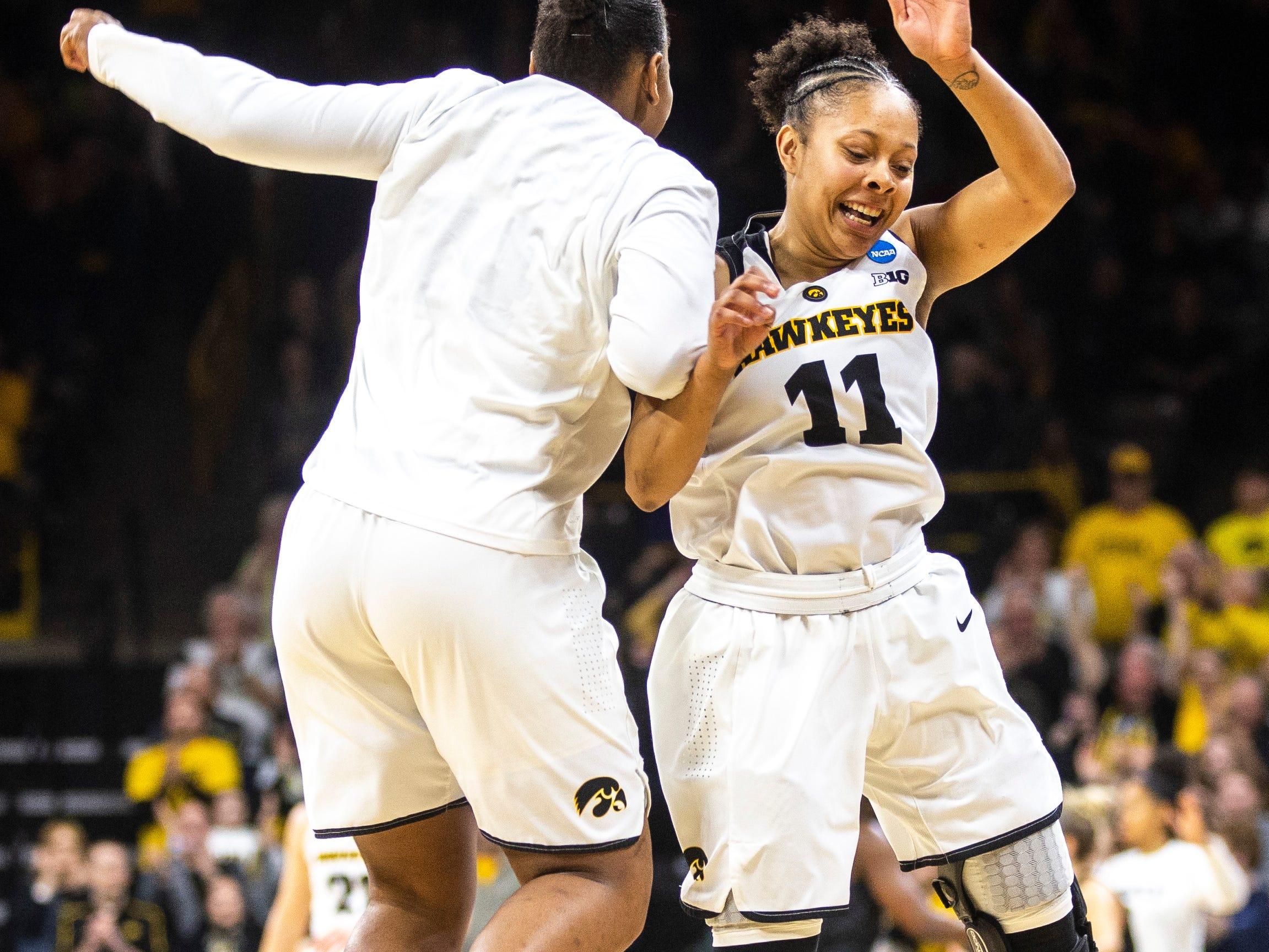 Iowa guard Tania Davis (11) celebrates with teammate Iowa guard Zion Sanders, left, during a NCAA women's basketball tournament second-round game, Sunday, March 24, 2019, at Carver-Hawkeye Arena in Iowa City, Iowa.