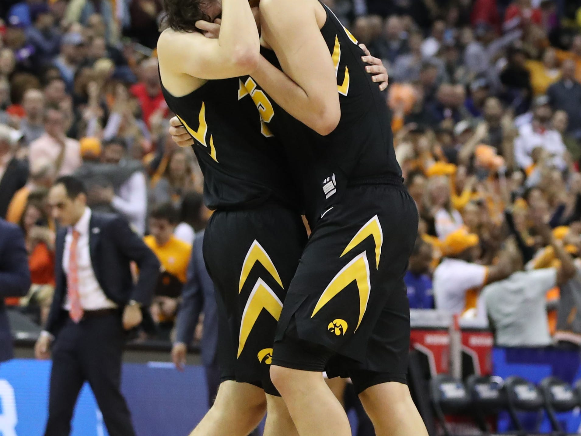 Iowa Hawkeyes forward Nicholas Baer (51) and forward Luka Garza (55) react to losing to the Tennessee Volunteers in overtime in the second round of the 2019 NCAA Tournament at Nationwide Arena.