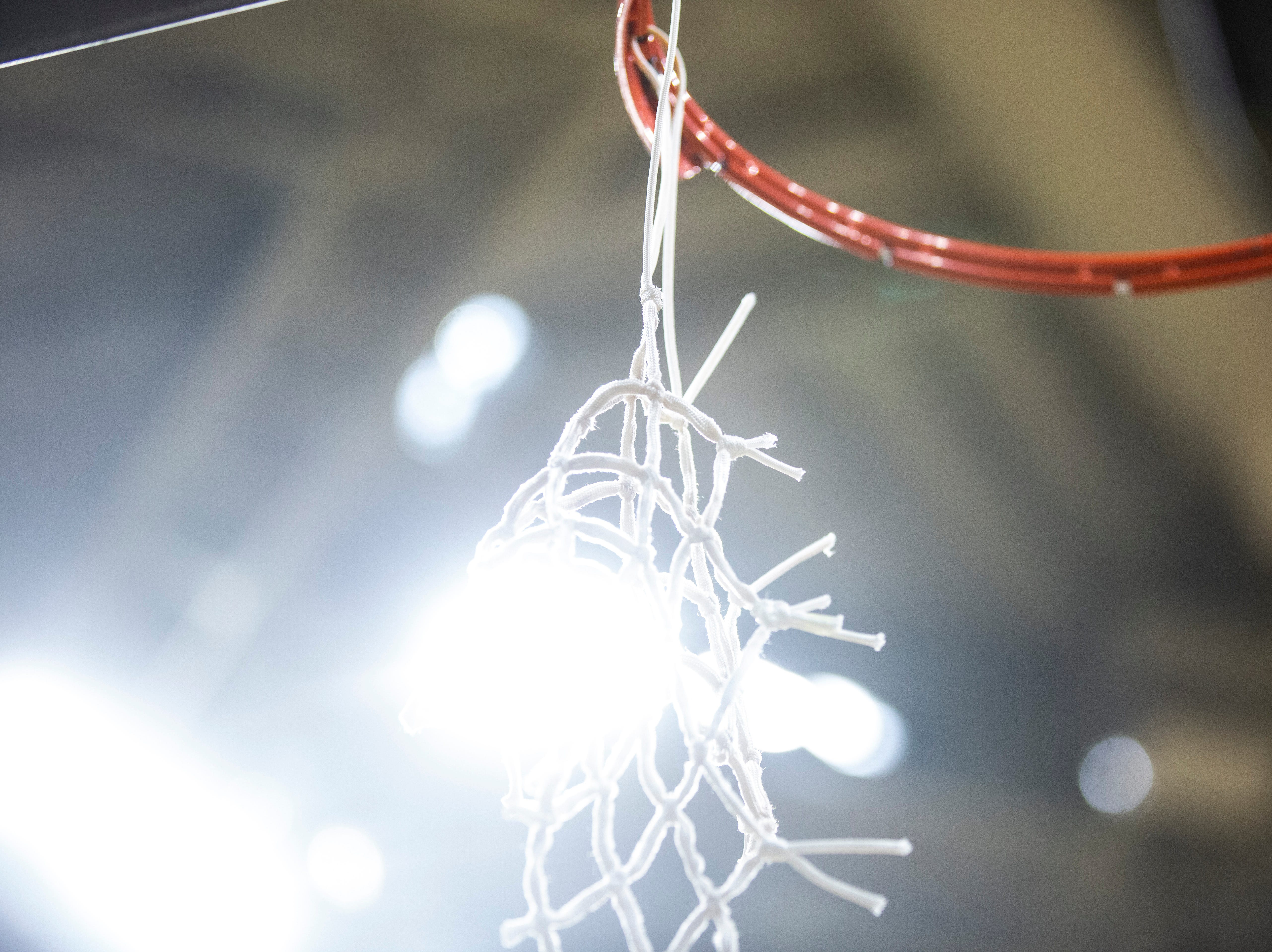 The net hangs from its rim after a NCAA women's basketball tournament second-round game, Sunday, March 24, 2019, at Carver-Hawkeye Arena in Iowa City, Iowa.