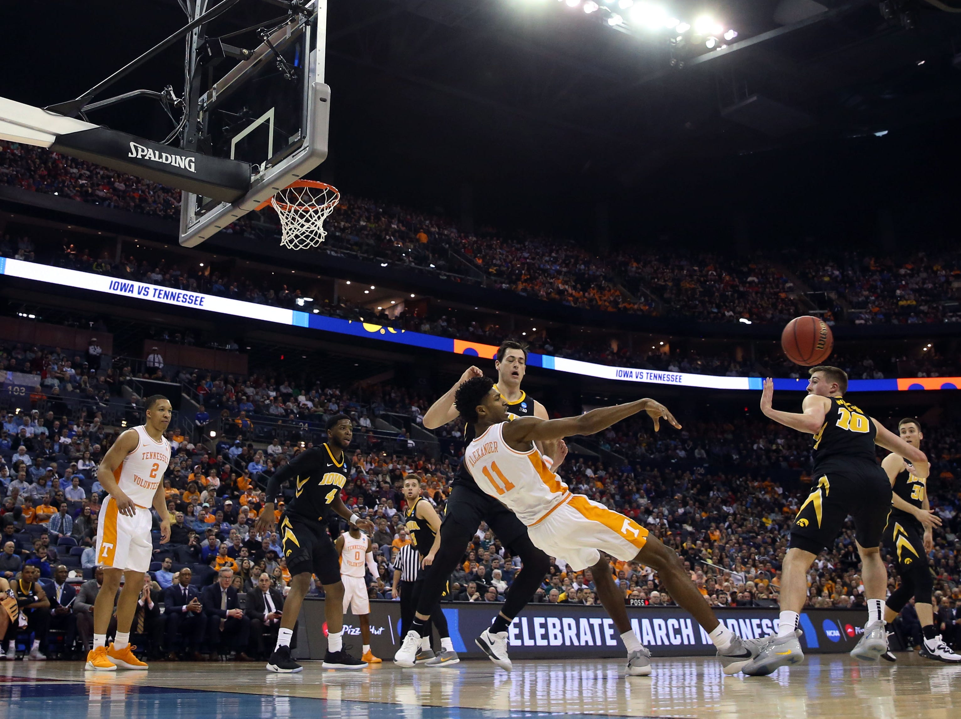 Tennessee Volunteers forward Kyle Alexander (11) falls to the ground while passing the ball in the first half against the Iowa Hawkeyes  in the second round of the 2019 NCAA Tournament at Nationwide Arena.