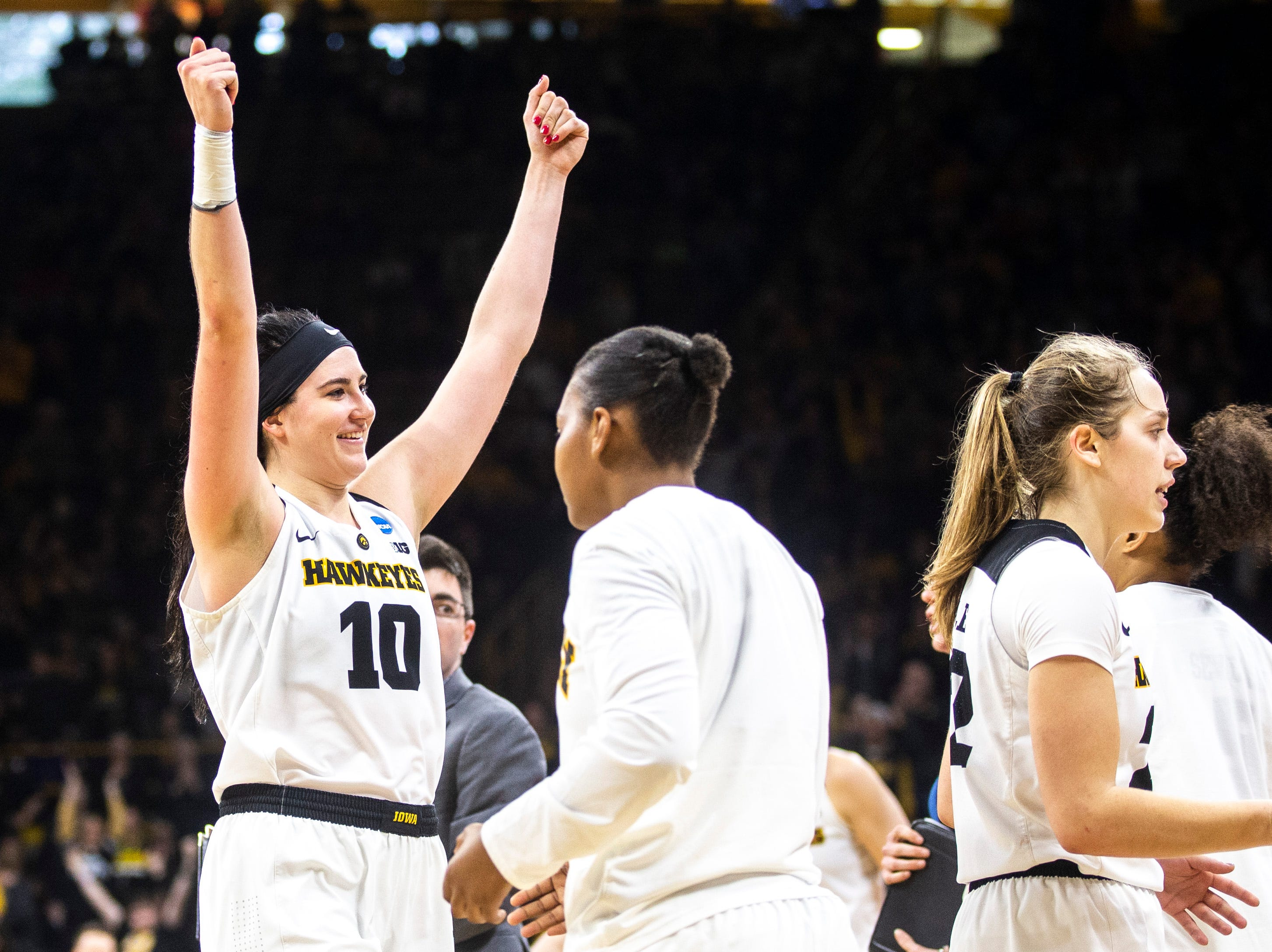 Iowa center Megan Gustafson (10) celebrates heading into a timeout during a NCAA women's basketball tournament second-round game, Sunday, March 24, 2019, at Carver-Hawkeye Arena in Iowa City, Iowa.