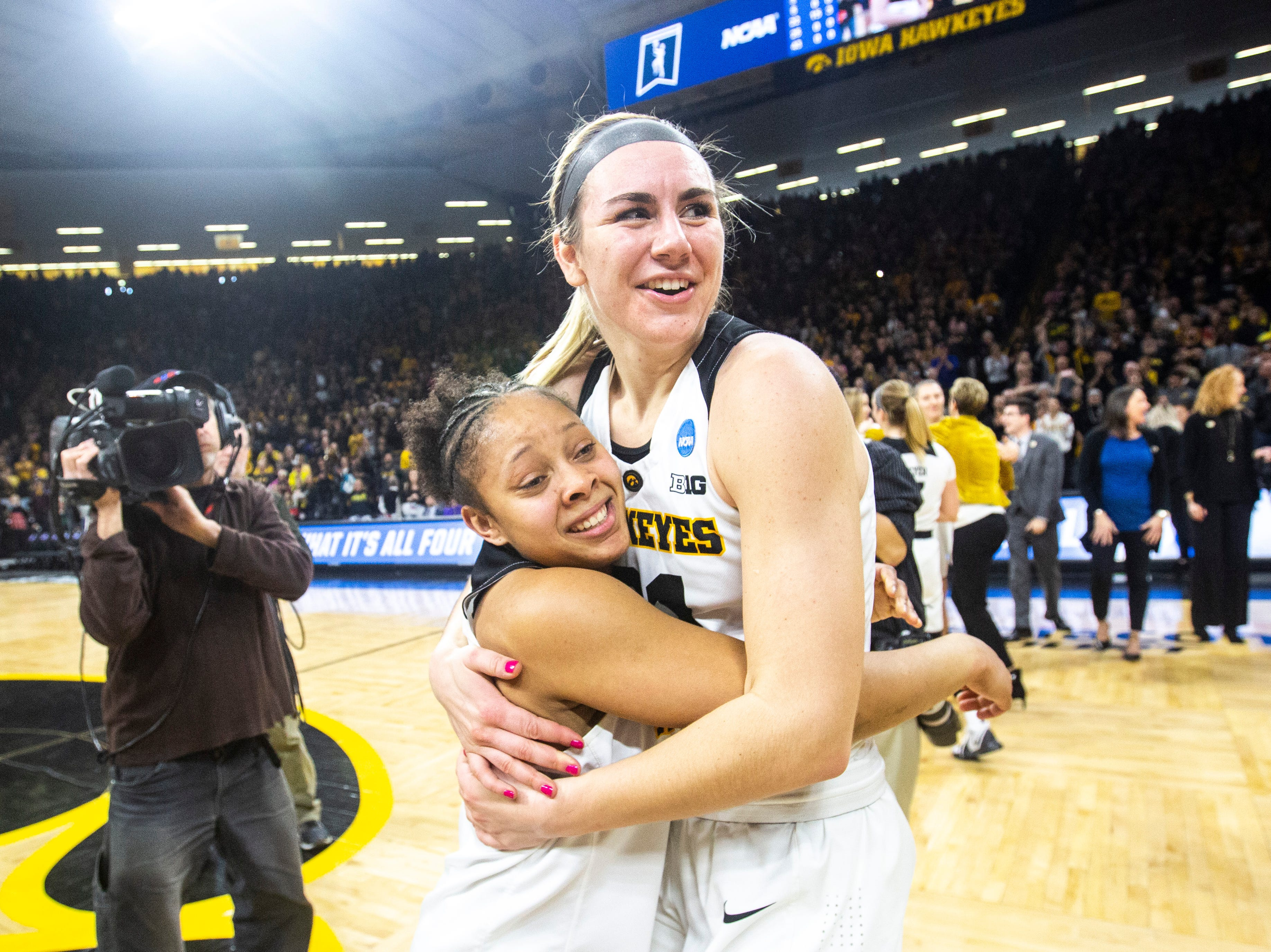 Iowa guard Tania Davis, left, embraces Iowa forward Hannah Stewart during a NCAA women's basketball tournament second-round game, Sunday, March 24, 2019, at Carver-Hawkeye Arena in Iowa City, Iowa.