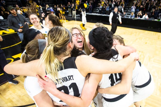 Iowa Hawkeyes players celebrate after a NCAA women's basketball tournament second-round game, Sunday, March 24, 2019, at Carver-Hawkeye Arena in Iowa City, Iowa. Iowa defeated Missouri, 68-52.