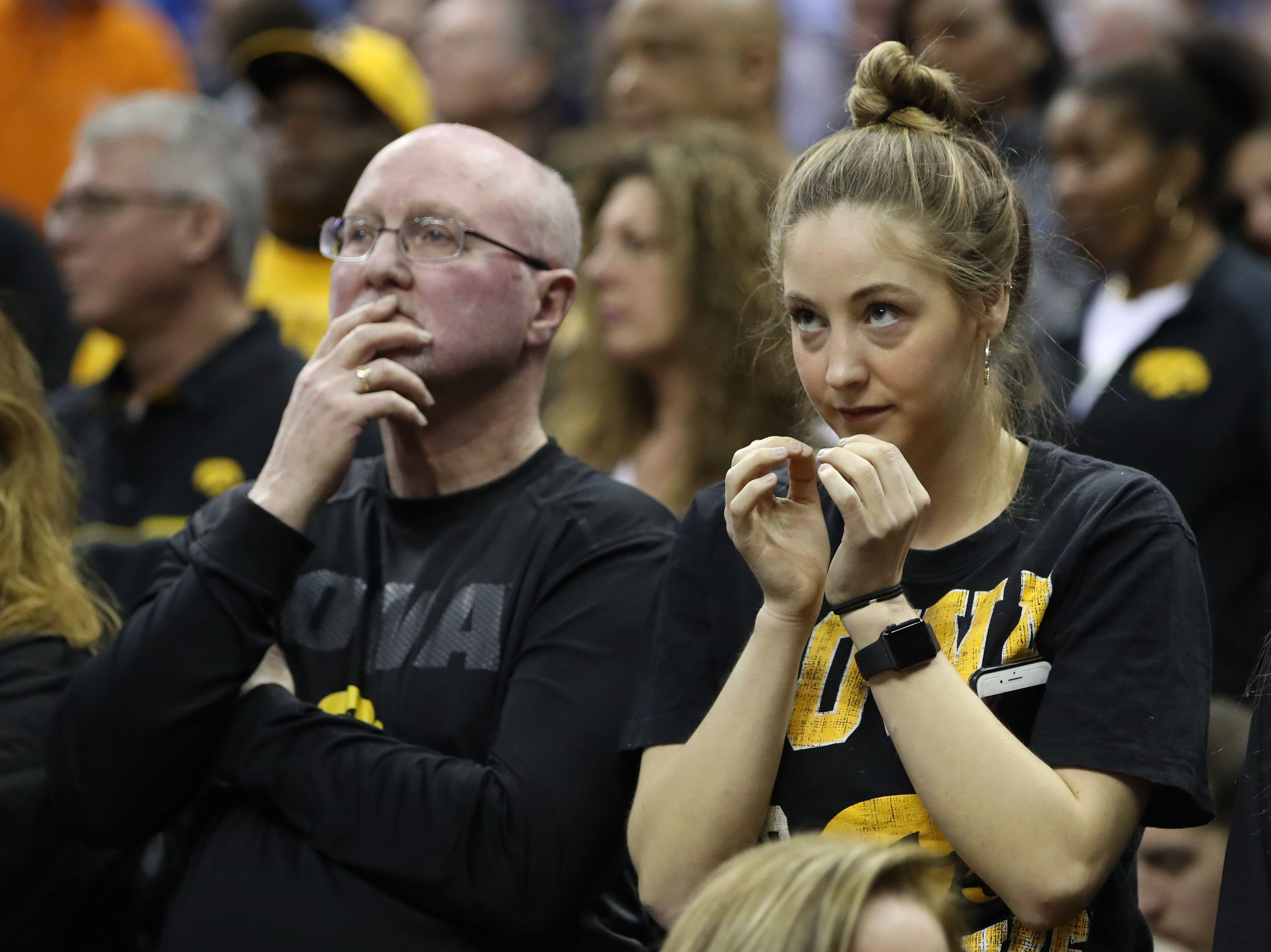 Iowa Hawkeyes fans watch the game against the Tennessee Volunteers in the second round of the 2019 NCAA Tournament at Nationwide Arena.