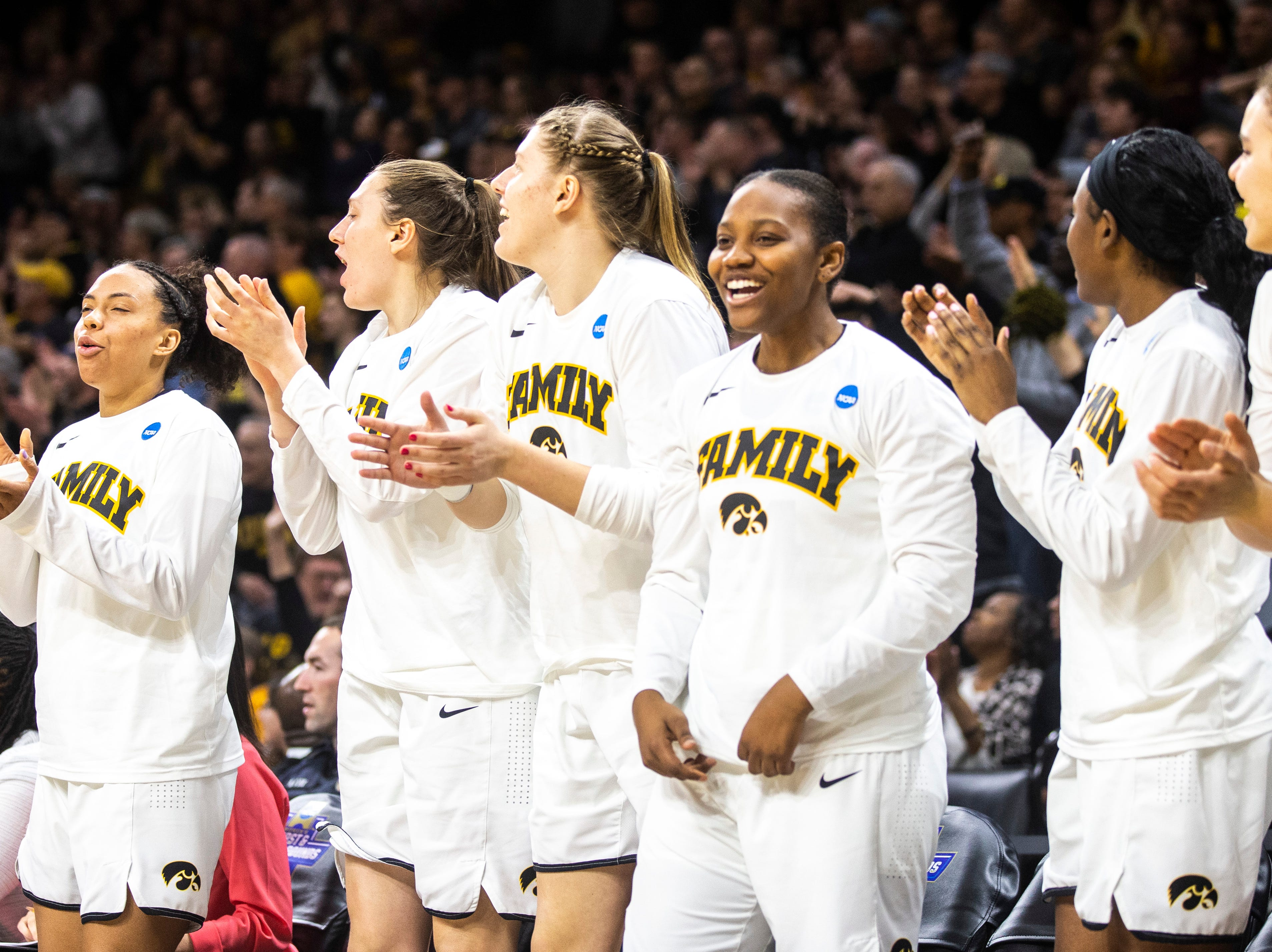 Iowa Hawkeyes bench cheers during a NCAA women's basketball tournament second-round game, Sunday, March 24, 2019, at Carver-Hawkeye Arena in Iowa City, Iowa.