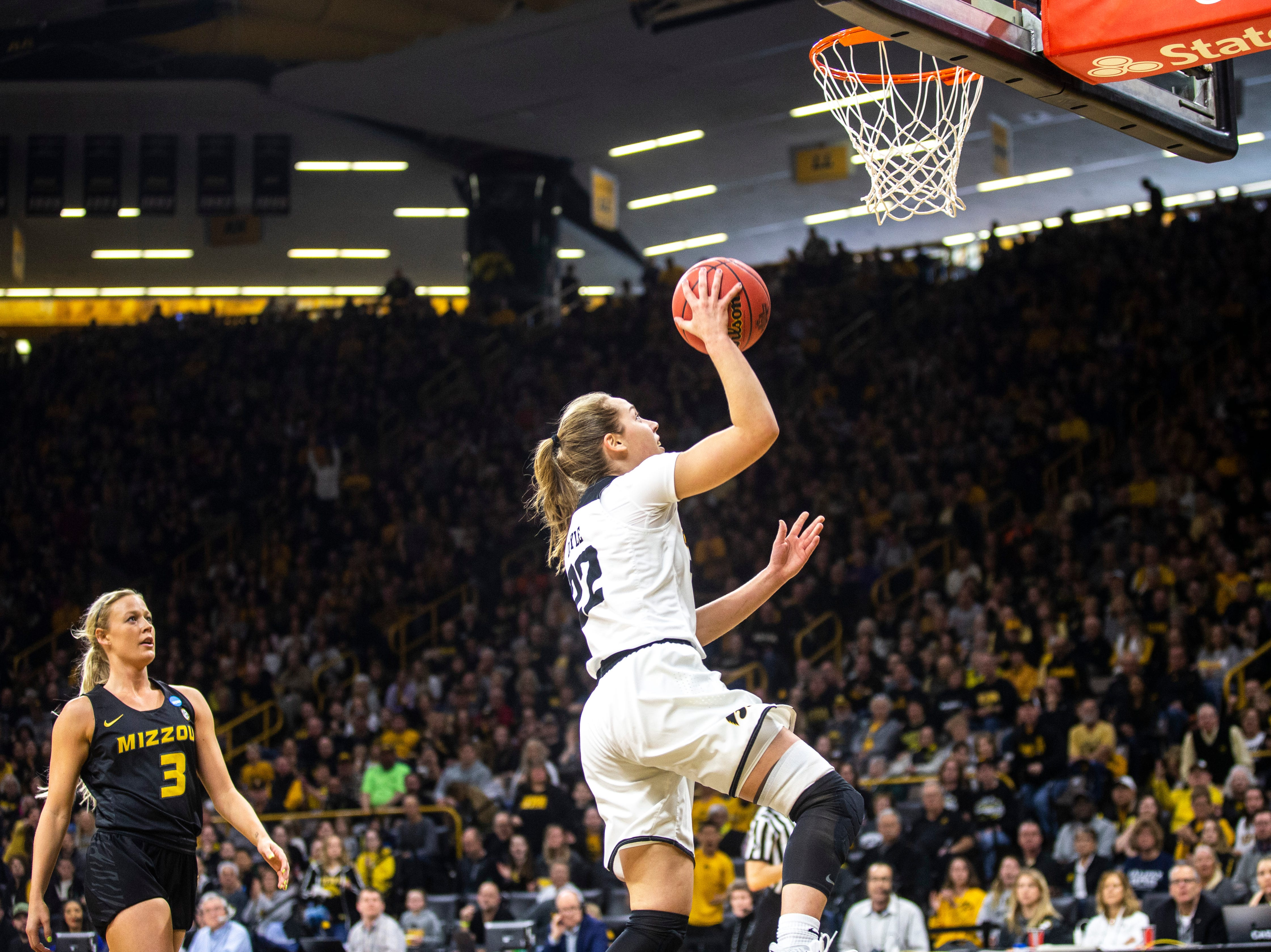 Iowa guard Kathleen Doyle (22) makes a basket while Missouri guard Sophie Cunningham (3) defends during a NCAA women's basketball tournament second-round game, Sunday, March 24, 2019, at Carver-Hawkeye Arena in Iowa City, Iowa.