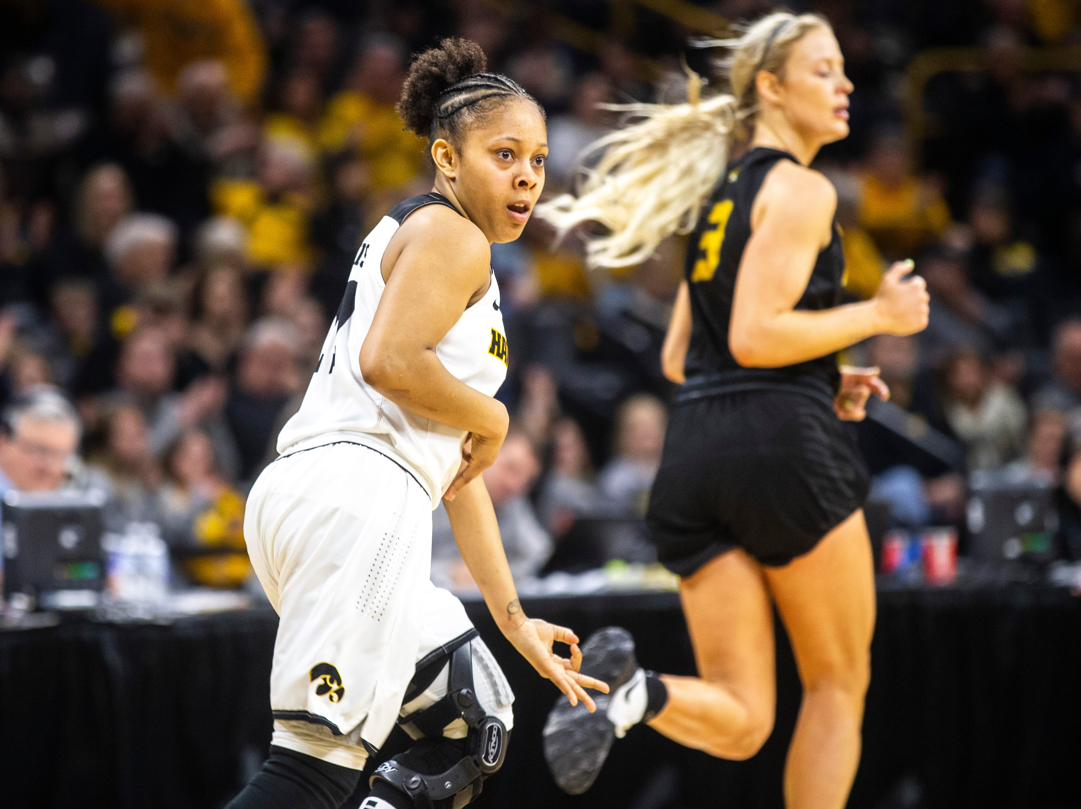Iowa guard Tania Davis (11) celebrates after making a 3-point basket during a NCAA women's basketball tournament second-round game, Sunday, March 24, 2019, at Carver-Hawkeye Arena in Iowa City, Iowa.