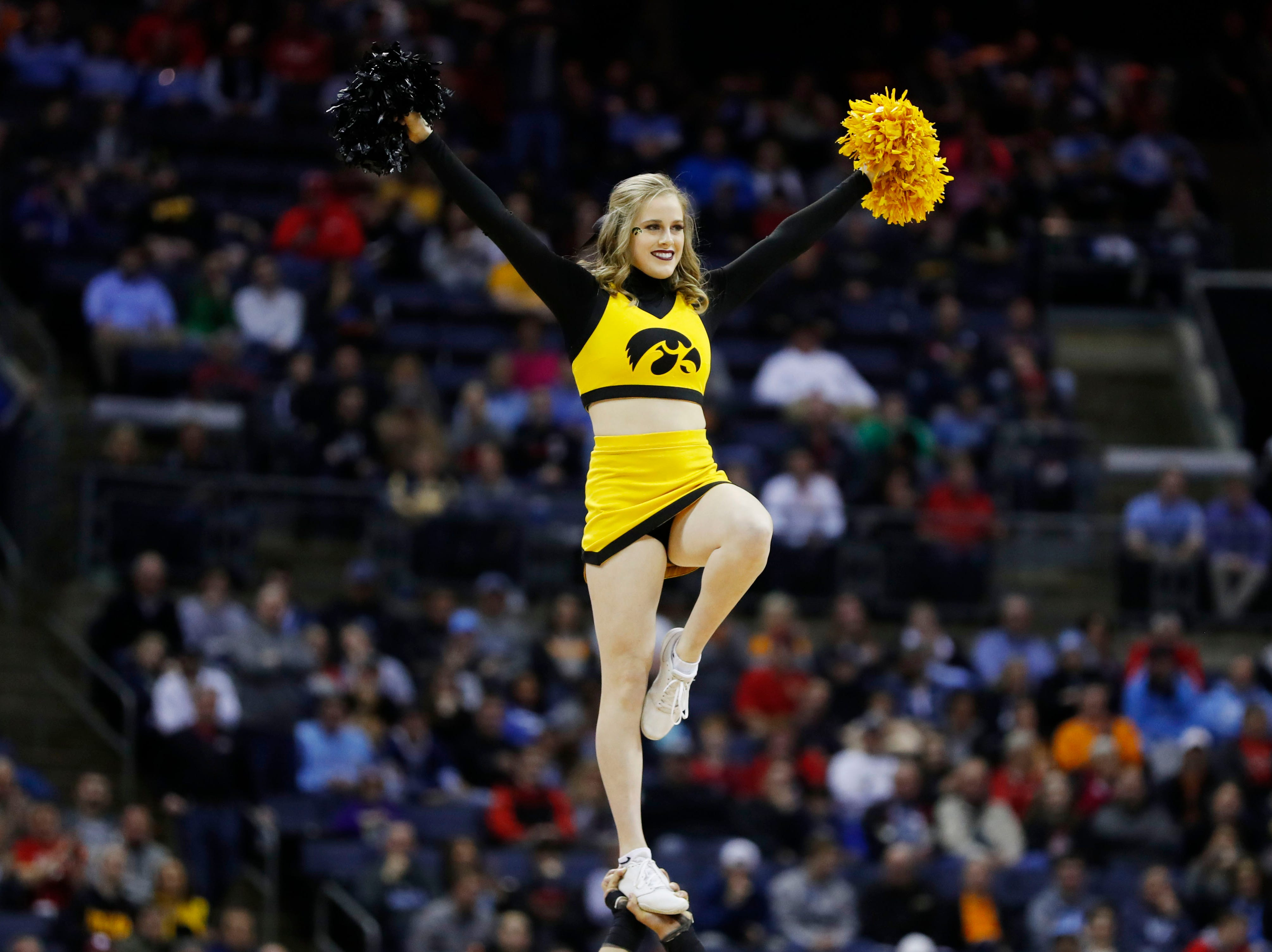 Iowa Hawkeyes cheerleader in the first half against the Tennessee Volunteers in the second round of the 2019 NCAA Tournament at Nationwide Arena.