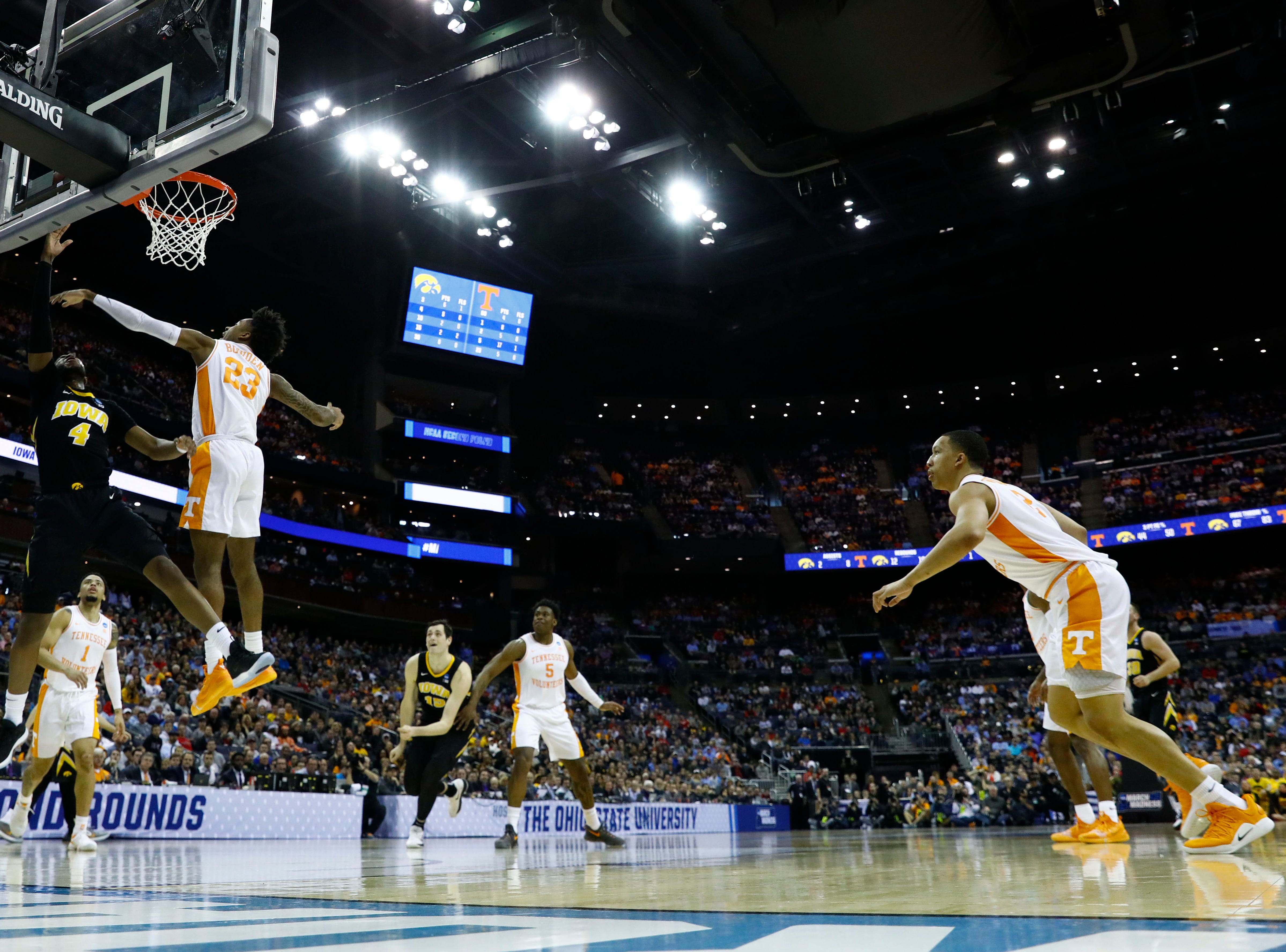 Tennessee Volunteers guard Jordan Bowden (23) blocks a shot from Iowa Hawkeyes guard Isaiah Moss (4) in the first half in the second round of the 2019 NCAA Tournament at Nationwide Arena.