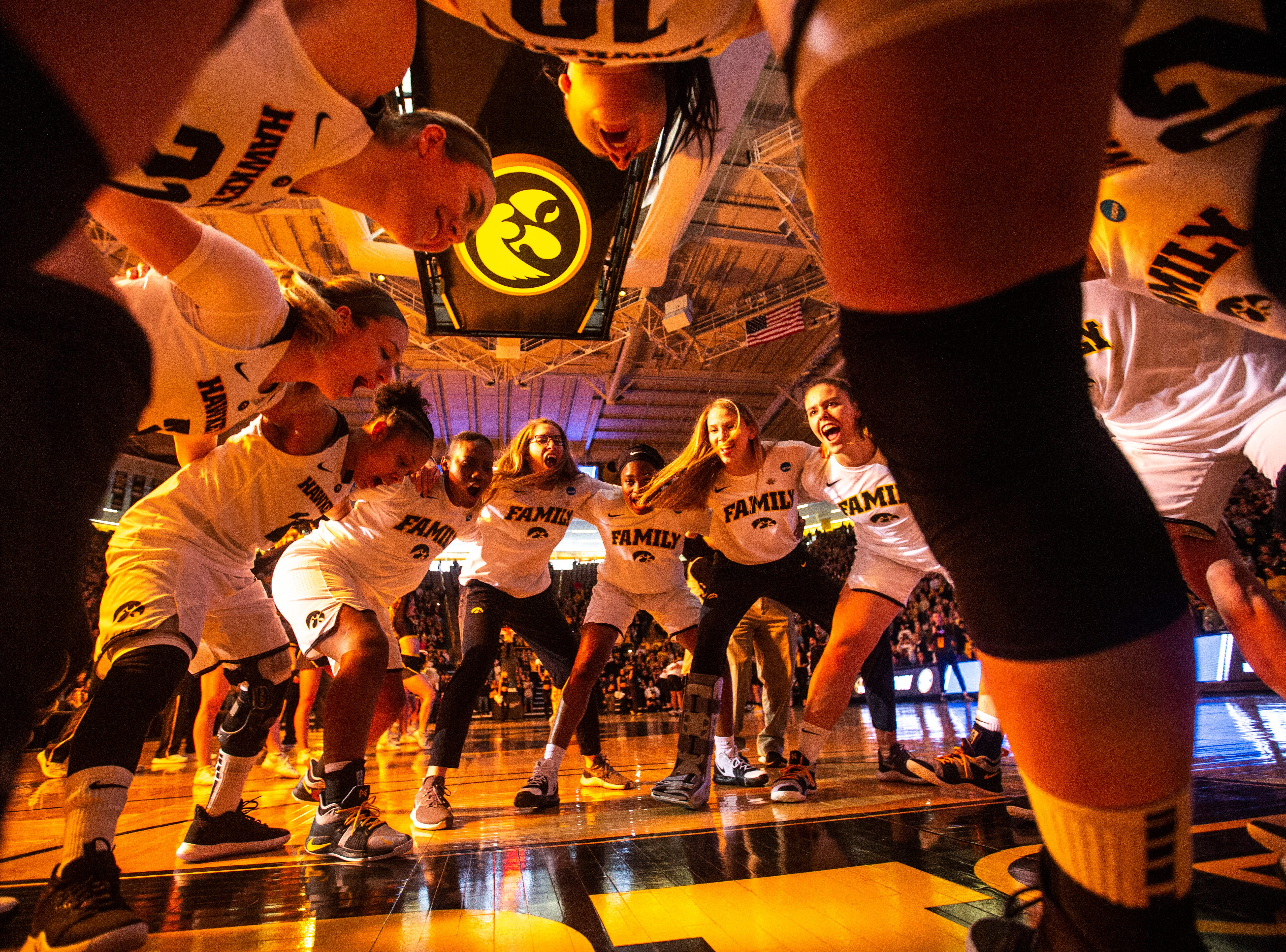 Iowa Hawkeyes, including Iowa center Megan Gustafson (10) huddle up following introductions during a NCAA women's basketball tournament second-round game, Sunday, March 24, 2019, at Carver-Hawkeye Arena in Iowa City, Iowa.