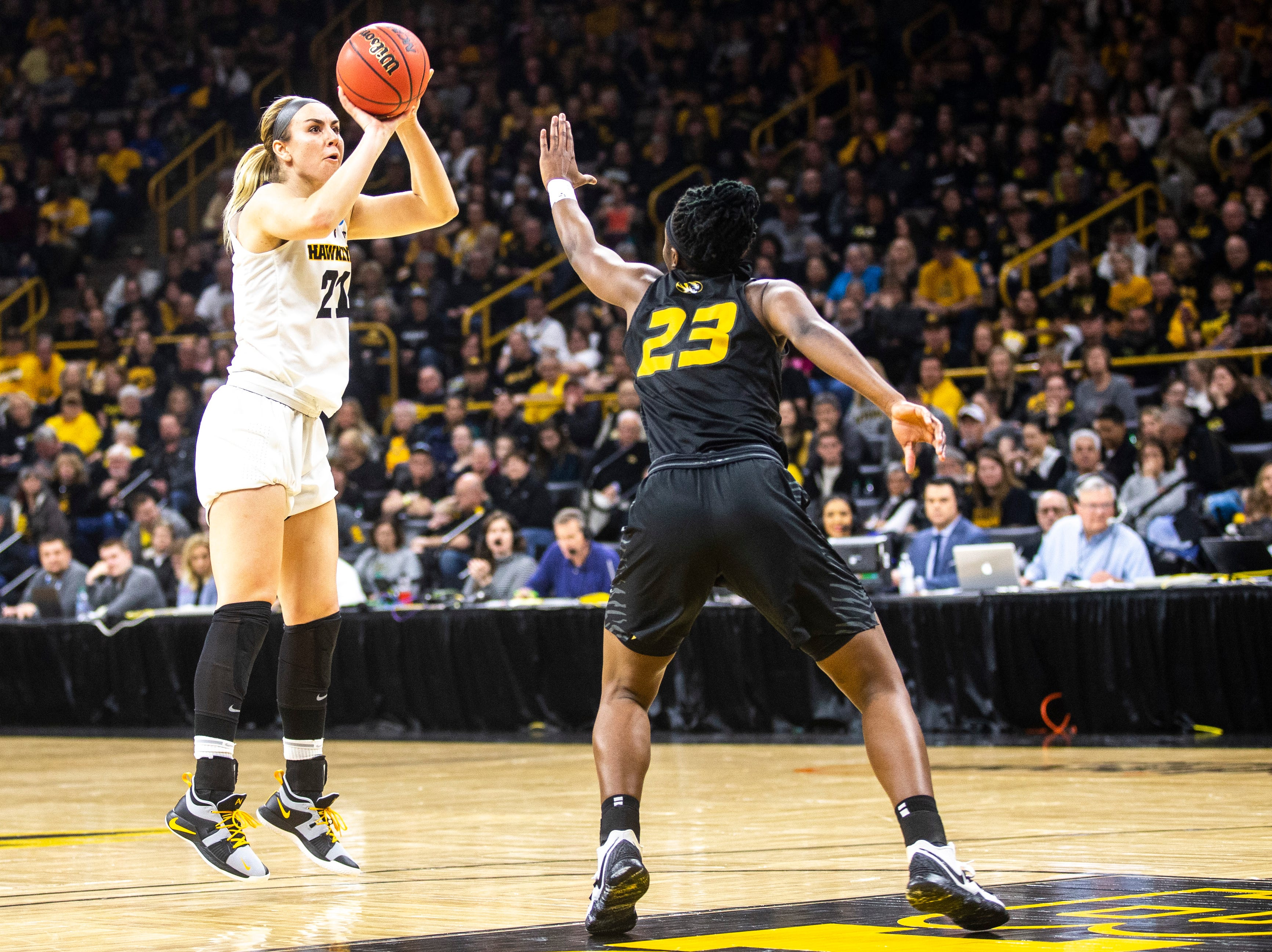 Iowa forward Hannah Stewart (21) shoots a basket against Missouri guard Amber Smith (23) during a NCAA women's basketball tournament second-round game, Sunday, March 24, 2019, at Carver-Hawkeye Arena in Iowa City, Iowa.