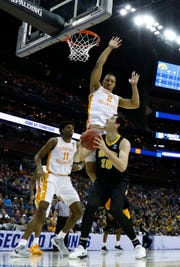 Tennessee forward Grant Williams (2) leaps to bother Iowa center Ryan Kriener in the first half of Sunday's NCAA Tournament game at Nationwide Arena in Columbus, Ohio.
