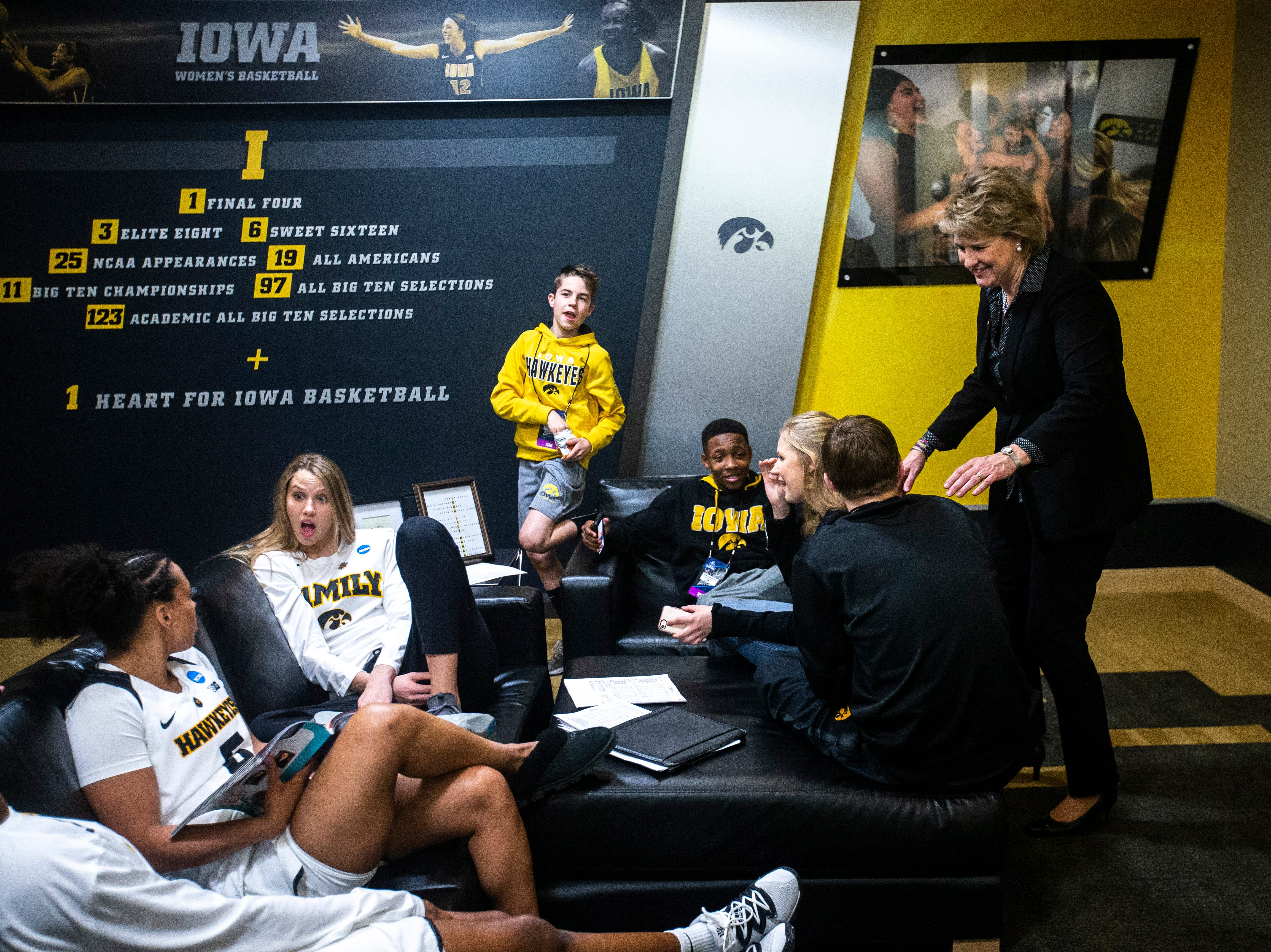 Iowa head coach Lisa Bluder talks with her children in the locker room after a NCAA women's basketball tournament second-round game, Sunday, March 24, 2019, at Carver-Hawkeye Arena in Iowa City, Iowa.