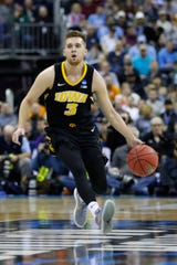Iowa Hawkeyes guard Jordan Bohannon (3) dribbles down court in the first half against the Tennessee Volunteers in the second round of the 2019 NCAA Tournament at Nationwide Arena.