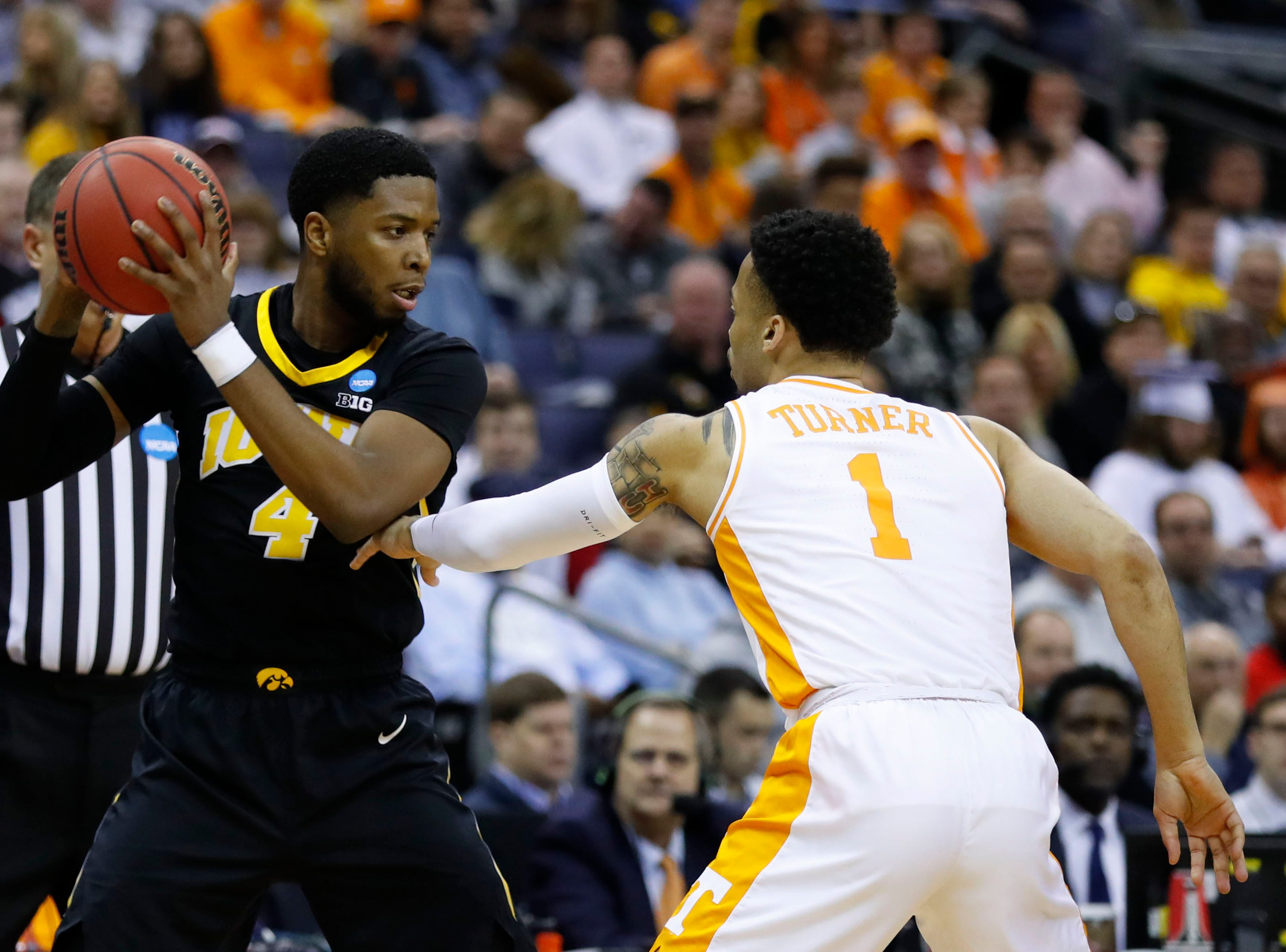 Iowa Hawkeyes guard Isaiah Moss (4) looks to move the ball defended by Tennessee Volunteers guard Lamonte Turner (1) in the first half in the second round of the 2019 NCAA Tournament at Nationwide Arena.