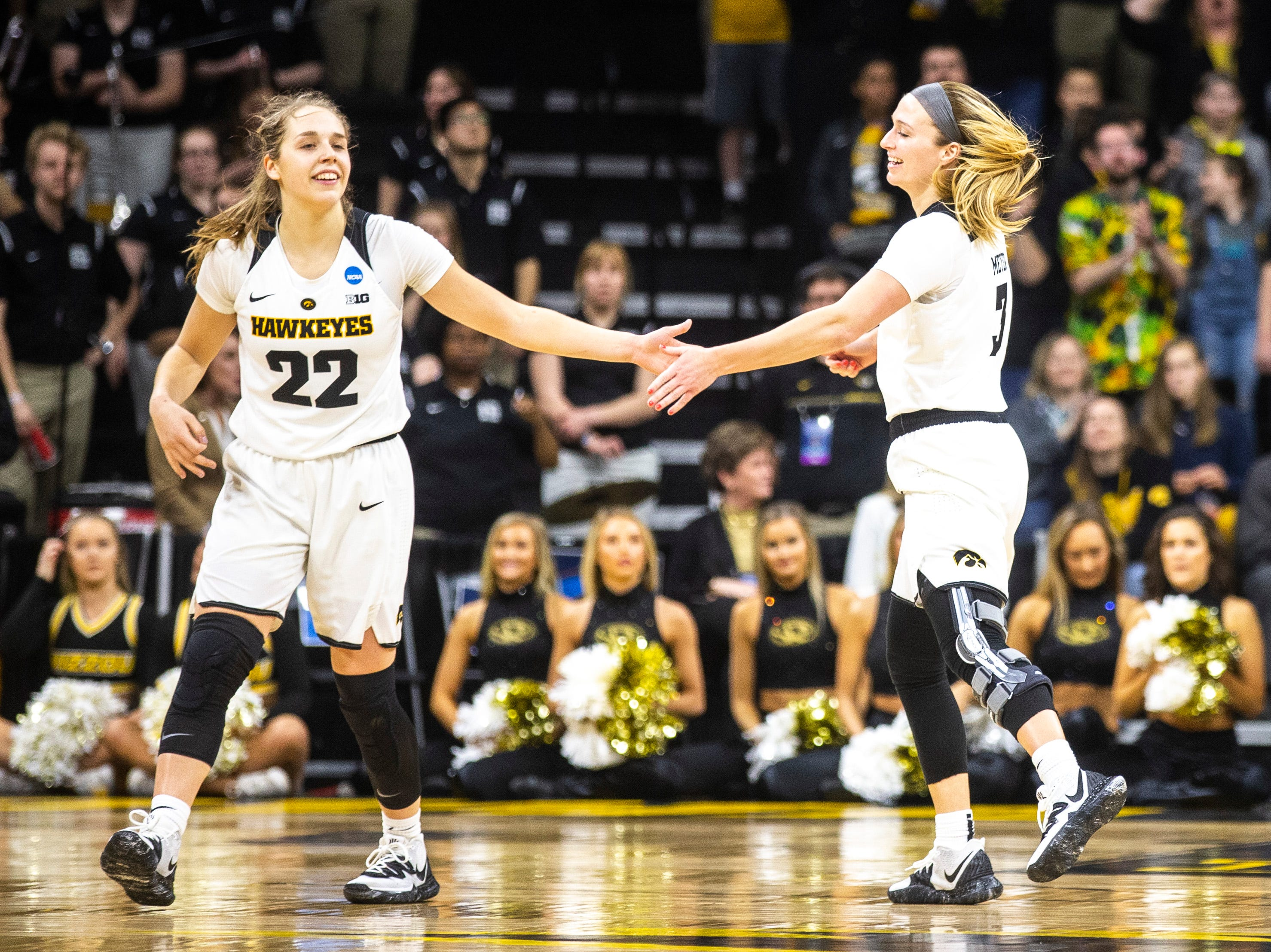 Iowa guard Kathleen Doyle (22) high-fives Iowa guard Makenzie Meyer (3) during a NCAA women's basketball tournament second-round game, Sunday, March 24, 2019, at Carver-Hawkeye Arena in Iowa City, Iowa.