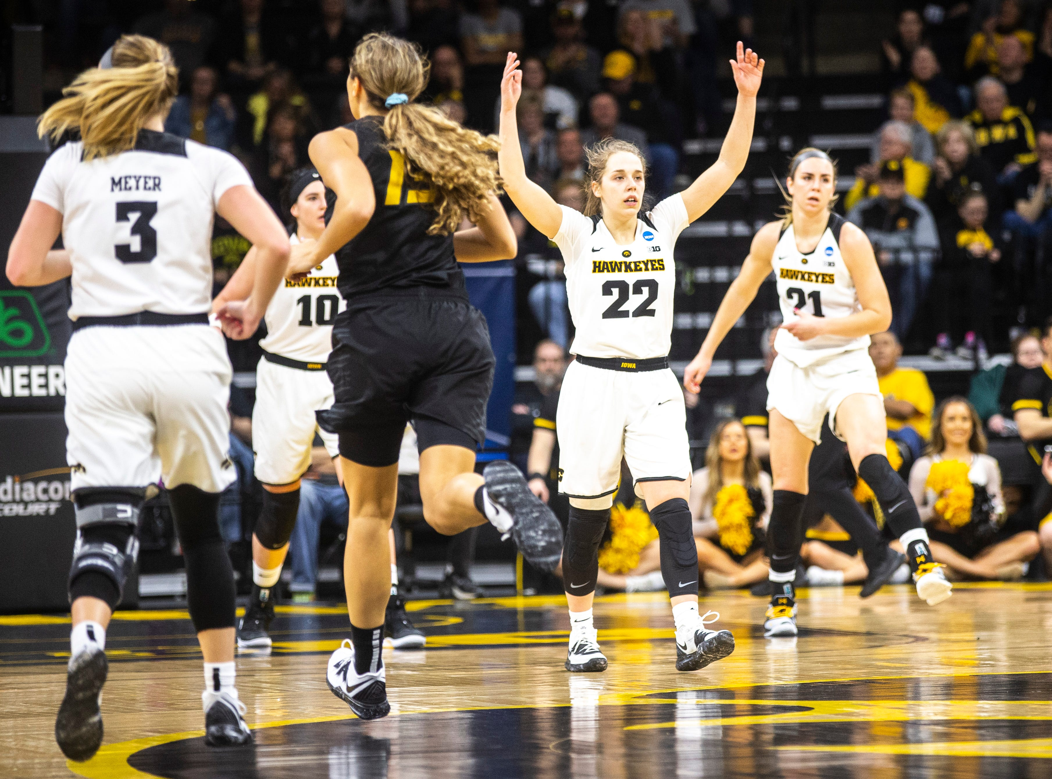 Iowa guard Kathleen Doyle (22) pumps up the crowd while settling in on defense during a NCAA women's basketball tournament second-round game, Sunday, March 24, 2019, at Carver-Hawkeye Arena in Iowa City, Iowa.