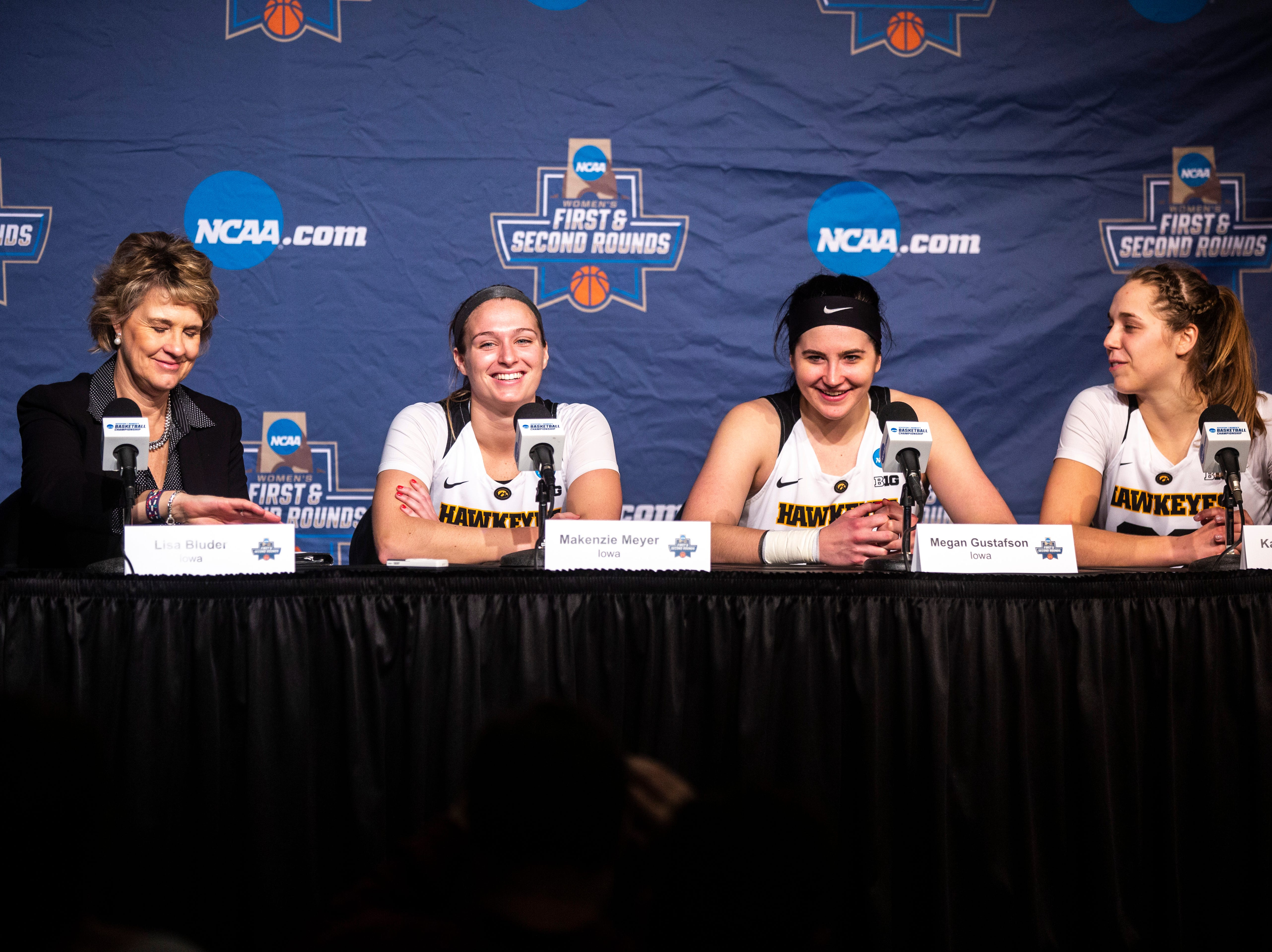 Iowa head coach Lisa Bluder is joined by guard Makenzie Meyer (3) center Megan Gustafson (10) and guard Kathleen Doyle (22) while they take questions from reporters after a NCAA women's basketball tournament second-round game, Sunday, March 24, 2019, at Carver-Hawkeye Arena in Iowa City, Iowa.