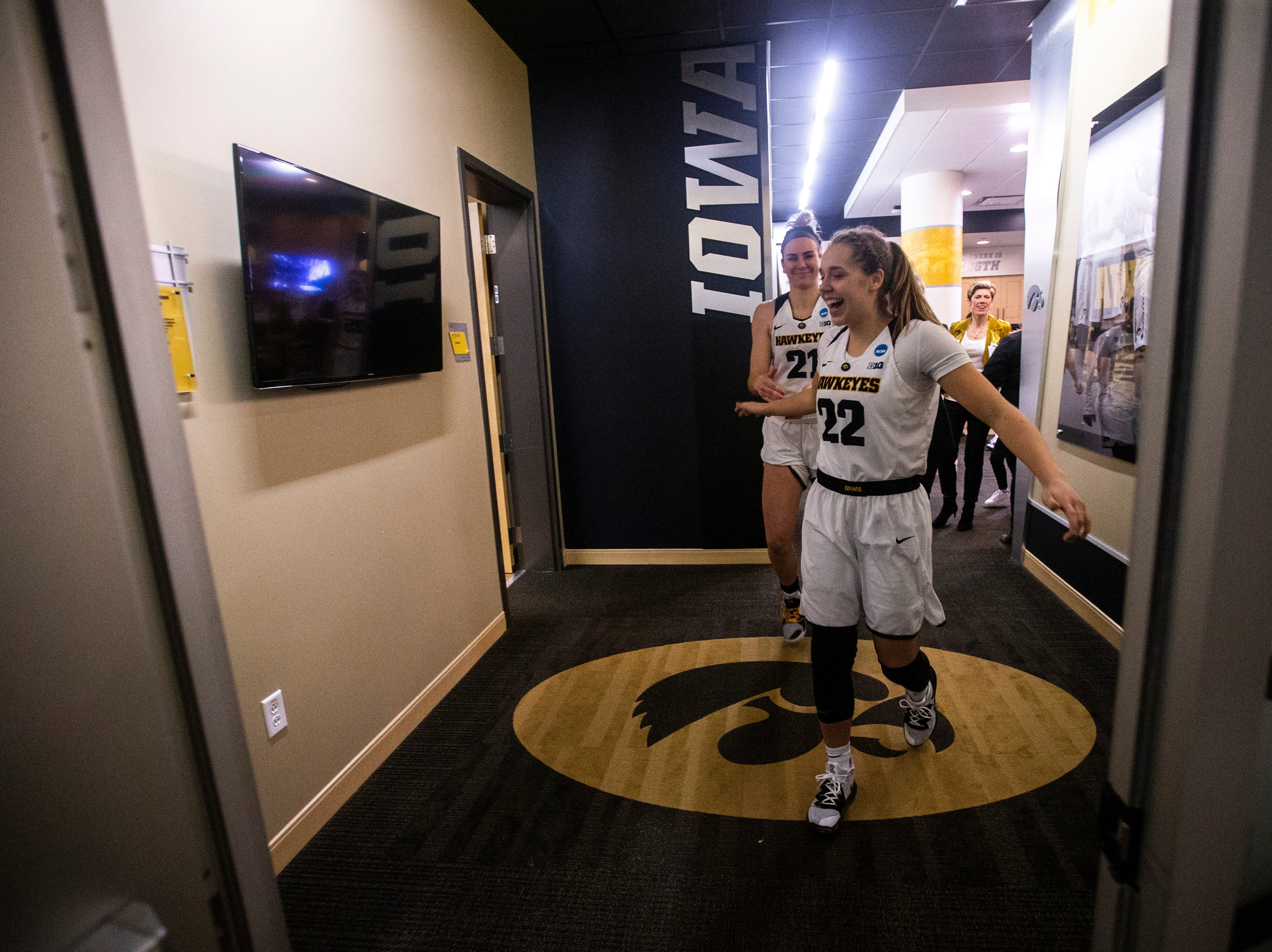 Iowa guard Kathleen Doyle (22) and forward Hannah Stewart (21) head out of the locker room to cut down the nets on the court after a NCAA women's basketball tournament second-round game, Sunday, March 24, 2019, at Carver-Hawkeye Arena in Iowa City, Iowa.