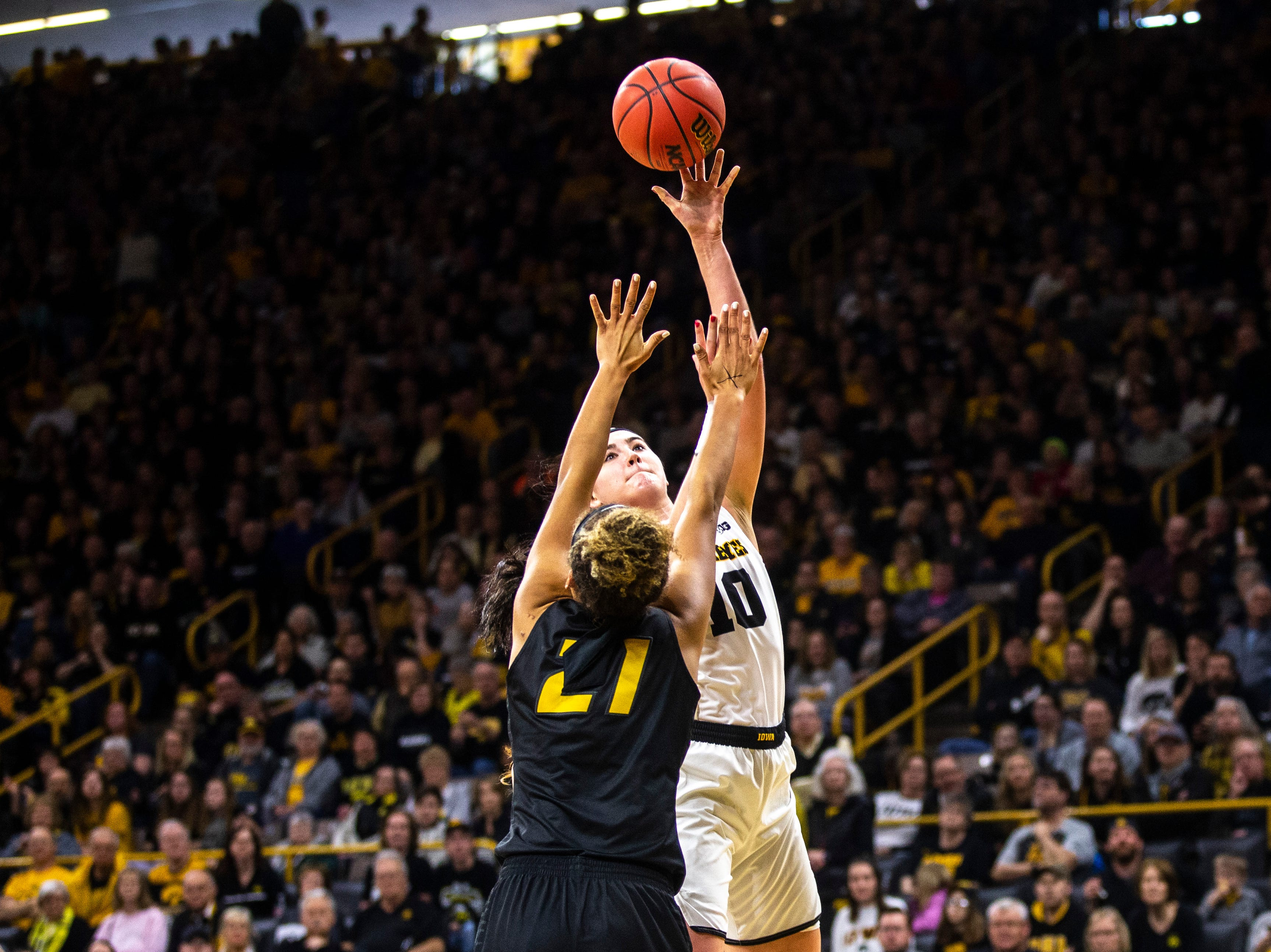 Iowa center Megan Gustafson (10) makes a basket against Missouri forward Cierra Porter (21) during a NCAA women's basketball tournament second-round game, Sunday, March 24, 2019, at Carver-Hawkeye Arena in Iowa City, Iowa.
