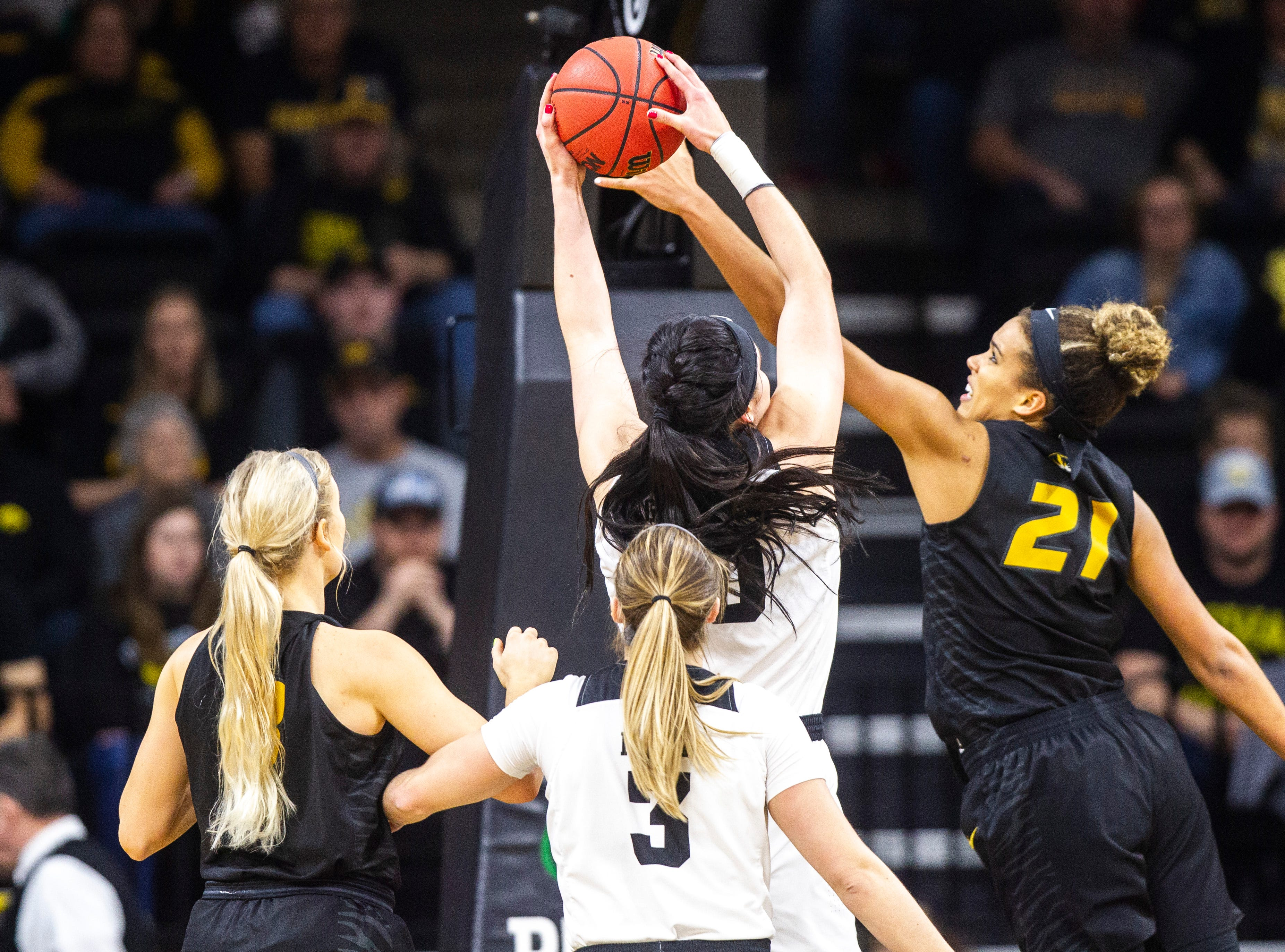 Iowa center Megan Gustafson (10) grabs a rebound against Missouri forward Cierra Porter (21) during a NCAA women's basketball tournament second-round game, Sunday, March 24, 2019, at Carver-Hawkeye Arena in Iowa City, Iowa.