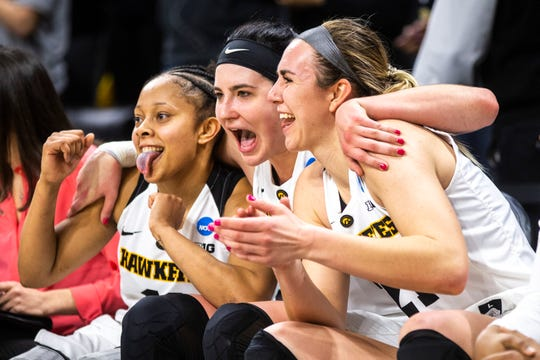 Iowa's three seniors (from left: Tania Davis, Megan Gustafson and Hannah Stewart) relish the final moments of their round-of-32 victory against Missouri. A Sweet 16 matchup against North Carolina State is next.