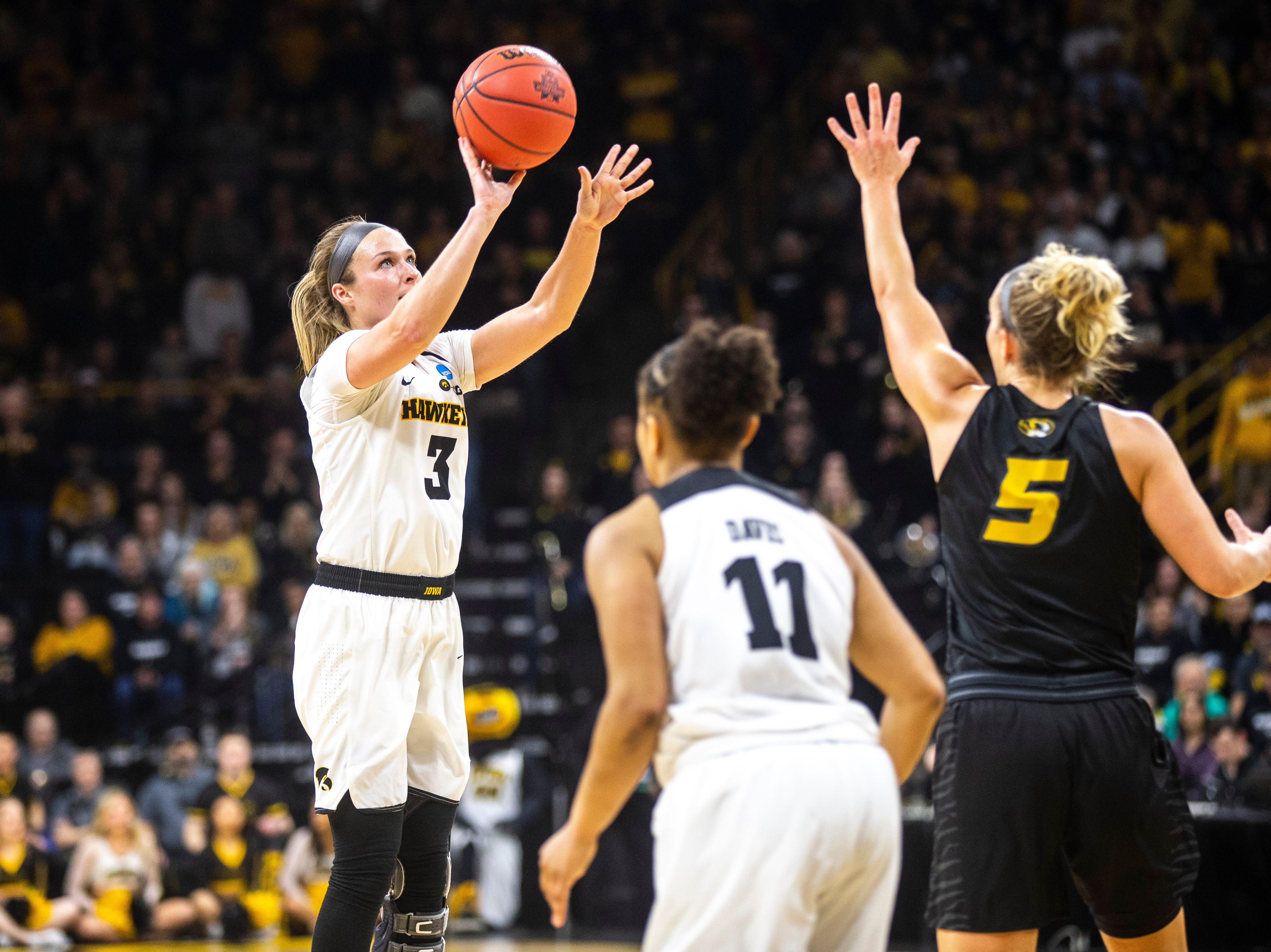 Iowa guard Makenzie Meyer (3) shoots a basket as Missouri guard Lauren Aldridge (5) defends during a NCAA women's basketball tournament second-round game, Sunday, March 24, 2019, at Carver-Hawkeye Arena in Iowa City, Iowa.