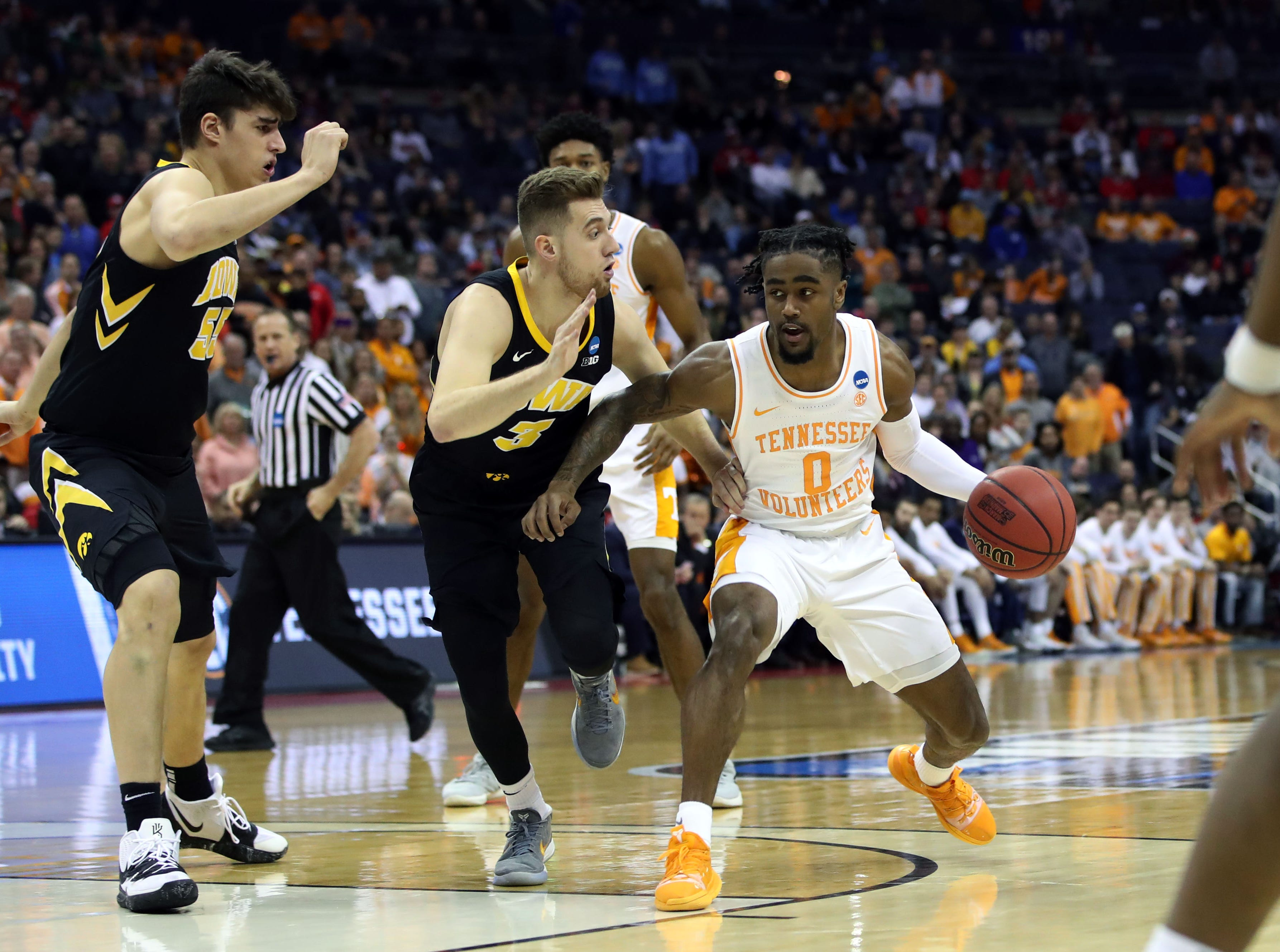 Tennessee Volunteers guard Jordan Bone (0) moves down court defended by Iowa Hawkeyes guard Jordan Bohannon (3) in the first half in the second round of the 2019 NCAA Tournament at Nationwide Arena.