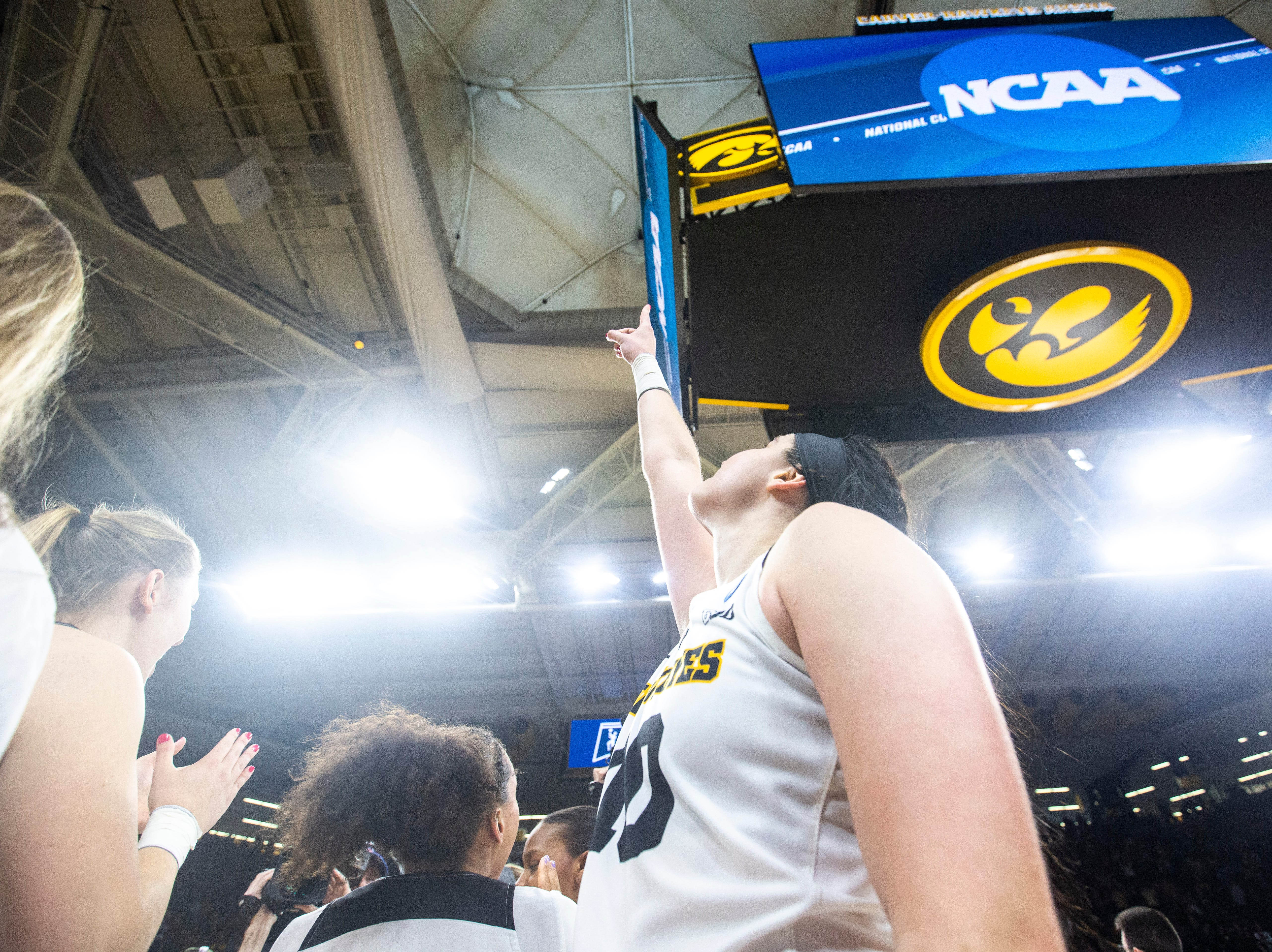 Iowa center Megan Gustafson (10) points upwards after a NCAA women's basketball tournament second-round game, Sunday, March 24, 2019, at Carver-Hawkeye Arena in Iowa City, Iowa.
