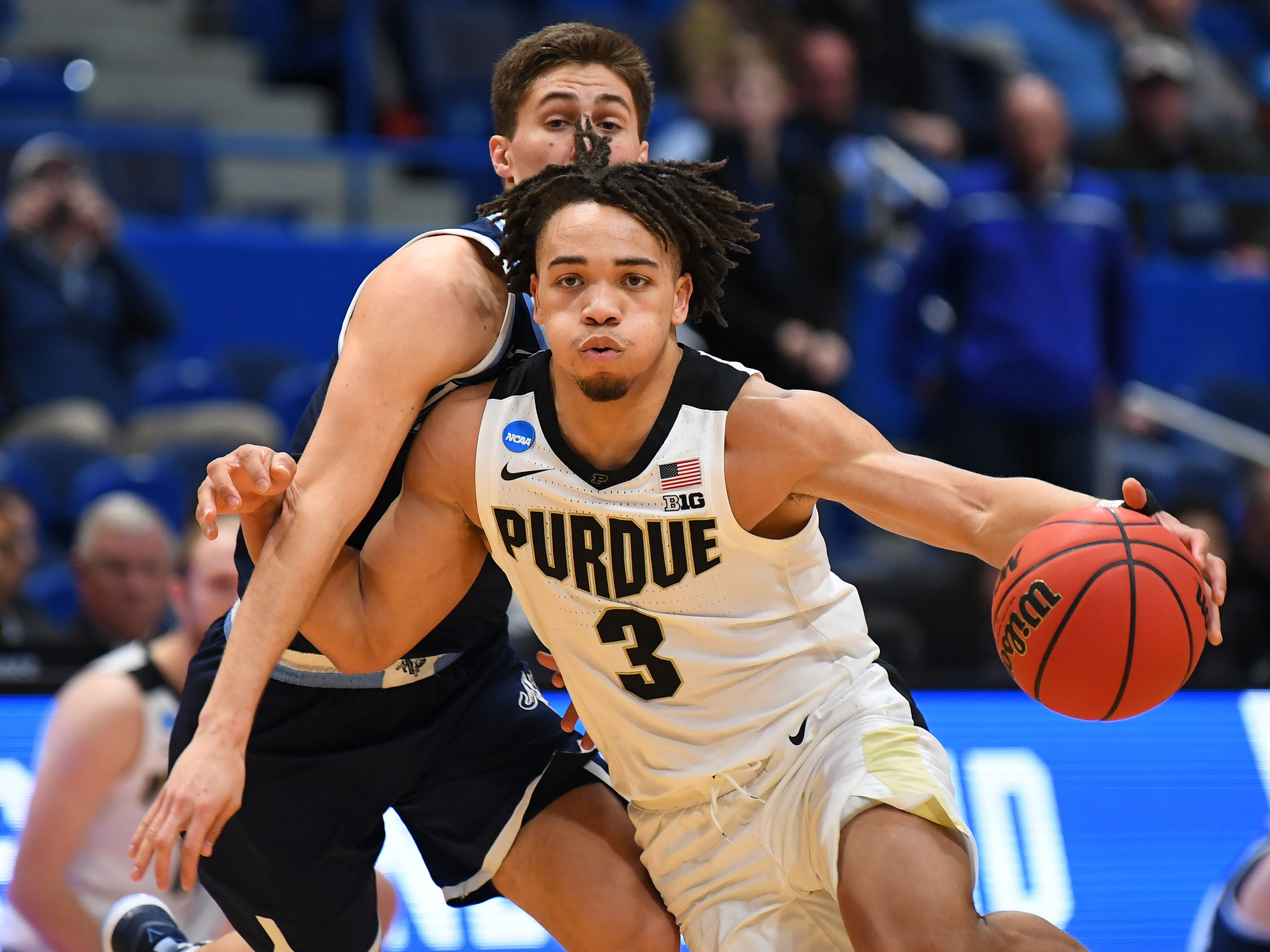 Mar 23, 2019; Hartford, CT, USA; Purdue Boilermakers guard Carsen Edwards (3) drives to the basket around Villanova Wildcats guard Collin Gillespie (2) during the second half of a game in the second round of the 2019 NCAA Tournament at XL Center. Mandatory Credit: Robert Deutsch-USA TODAY Sports