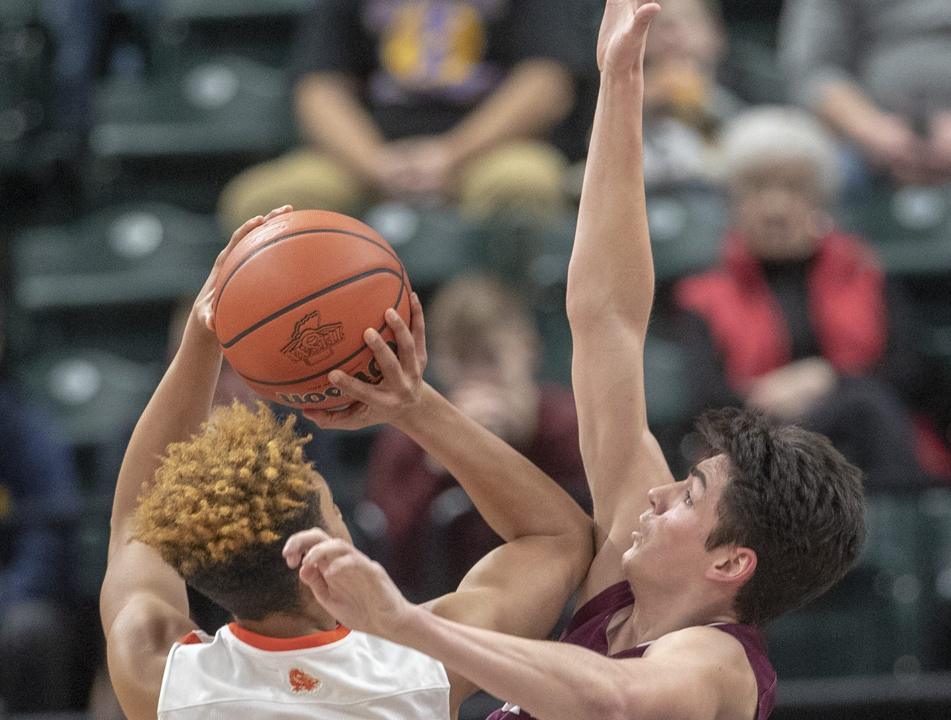 Trey Kaufman (left), of Silver Creek Dragons puts up a shot on Trey Galloway of Culver Academies in the Class 3S Boys Basketball State Final, Bankers Life Fieldhouse, Indianapolis, Saturday, March 23, 2019. Silver Creek won 52-49.