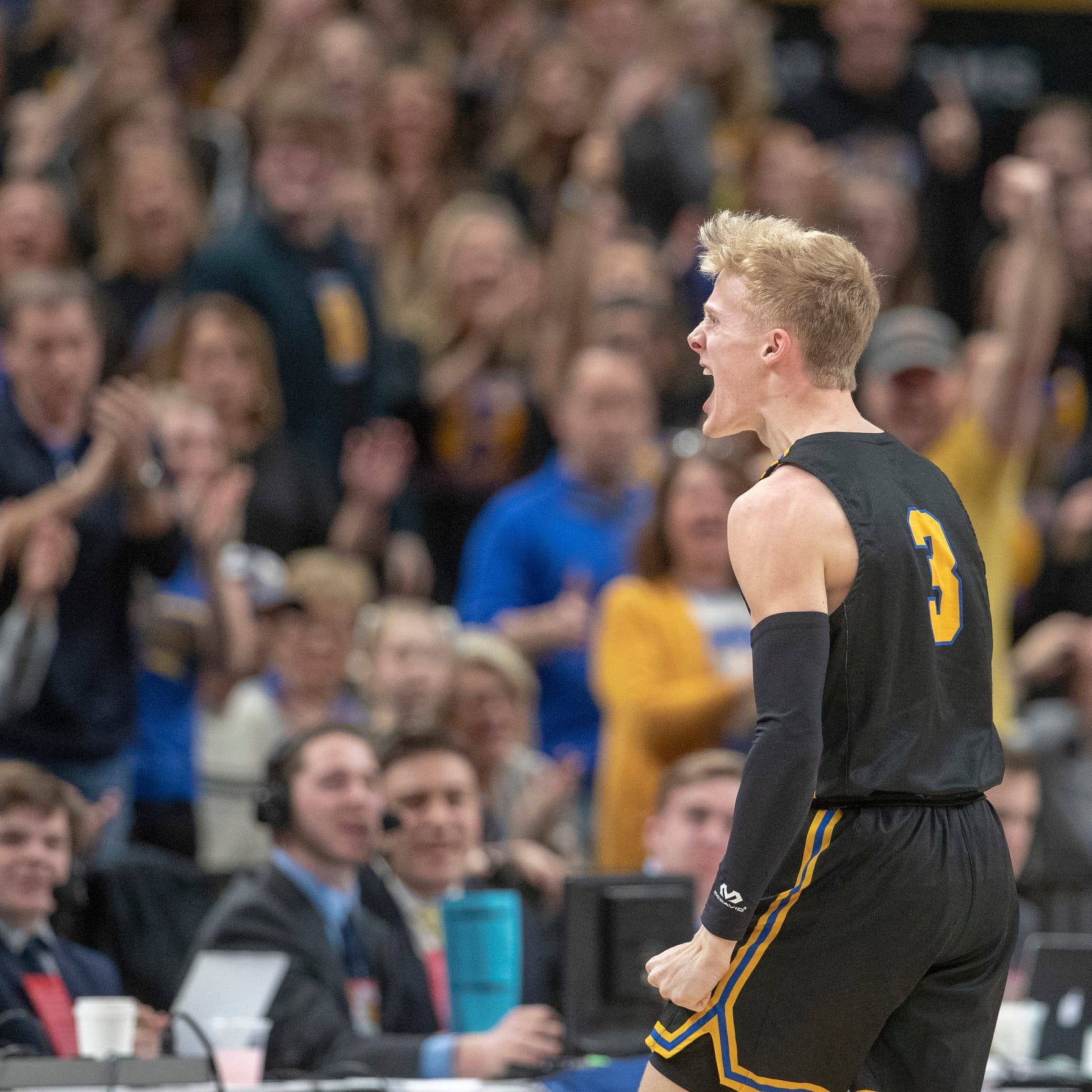 Karsten Windlan of Carmel High School pumps up his fans after coming up with a loose ball vs. Ben Davis in the Class 4A Boys Basketball State Final, Bankers Life Fieldhouse, Indianapolis, Saturday, March 23, 2019. Carmel won 60-55.