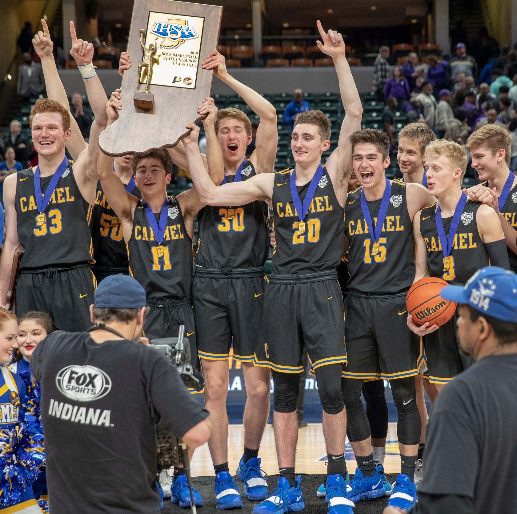 Carmel High School players celebrate post-game, Carmel vs. Ben Davis in the Class 4A Boys Basketball State Final, Bankers Life Fieldhouse, Indianapolis, Saturday, March 23, 2019. Carmel won 60-55.