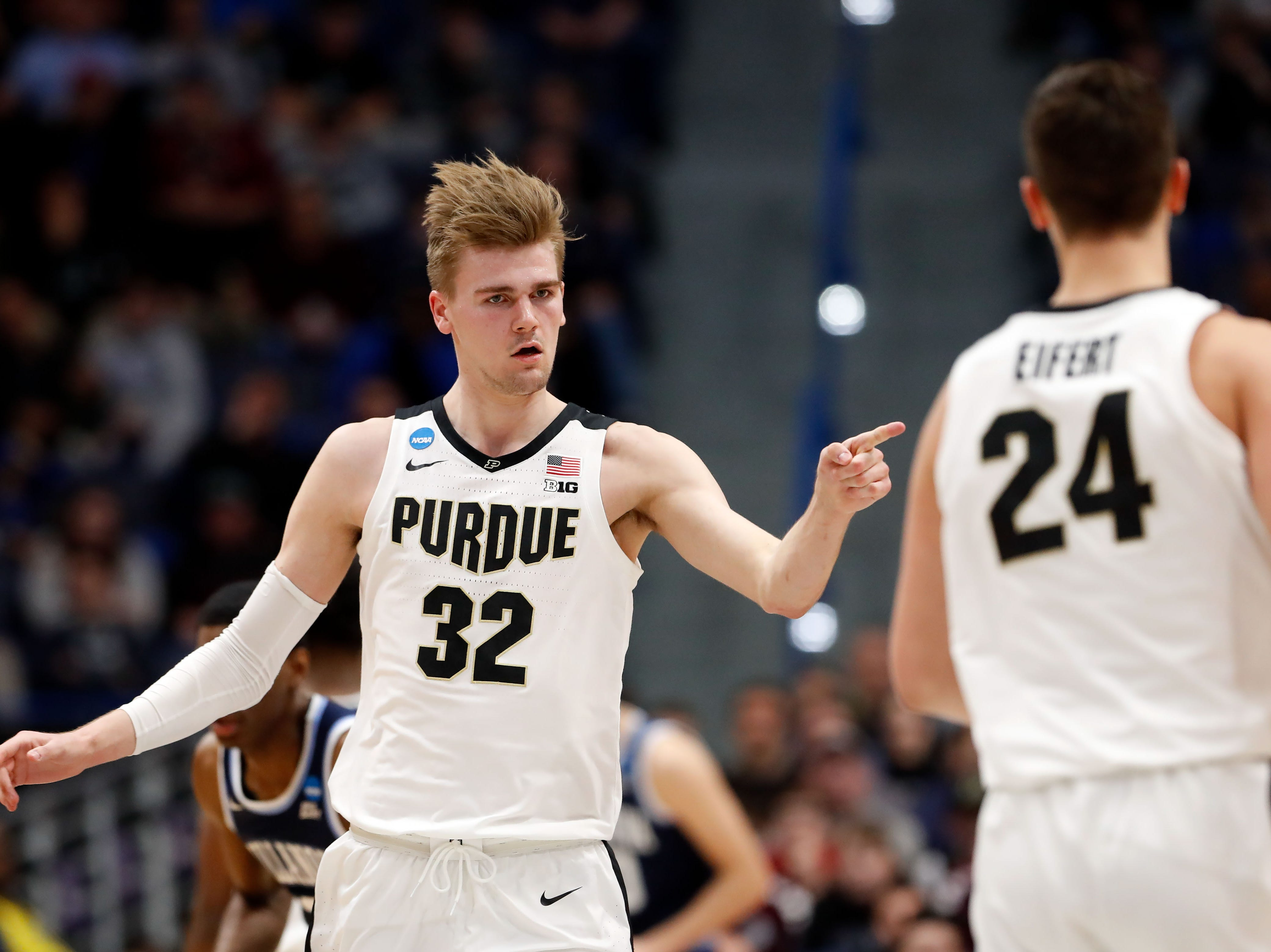 Mar 23, 2019; Hartford, CT, USA; Purdue Boilermakers center Matt Haarms (32) points to forward Grady Eifert (24) after a score against the Villanova Wildcats during the second half of a game in the second round of the 2019 NCAA Tournament at XL Center. Mandatory Credit: David Butler II-USA TODAY Sports