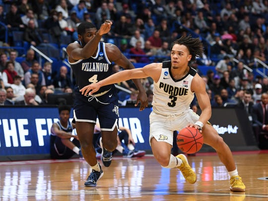 Mar 23, 2019; Hartford, CT, USA; Purdue Boilermakers guard Carsen Edwards (3) drives to the basket against Villanova Wildcats forward Eric Paschall (4) during the second half of a game in the second round of the 2019 NCAA Tournament at XL Center. Mandatory Credit: Robert Deutsch-USA TODAY Sports