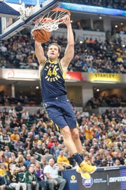 Indiana Pacers forward Bojan Bogdanovic (44) hits a big dunk during a game between the Indiana Pacers and the Denver Nuggets at Bankers Life Fieldhouse on Sunday, March 24, 2019.