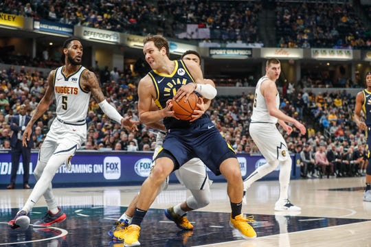 Indiana Pacers forward Bojan Bogdanovic (44) is fouled by Denver Nuggets Jamal Murray (27) during a game between the Indiana Pacers and the Denver Nuggets at Bankers Life Fieldhouse on Sunday, March 24, 2019.