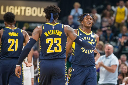Indiana Pacers center Myles Turner (33) and guard Wesley Matthews (23) celebrate a made basket in the first quarter against the Denver Nuggets at Bankers Life Fieldhouse. Mandatory Credit: Trevor Ruszkowski-USA TODAY Sports