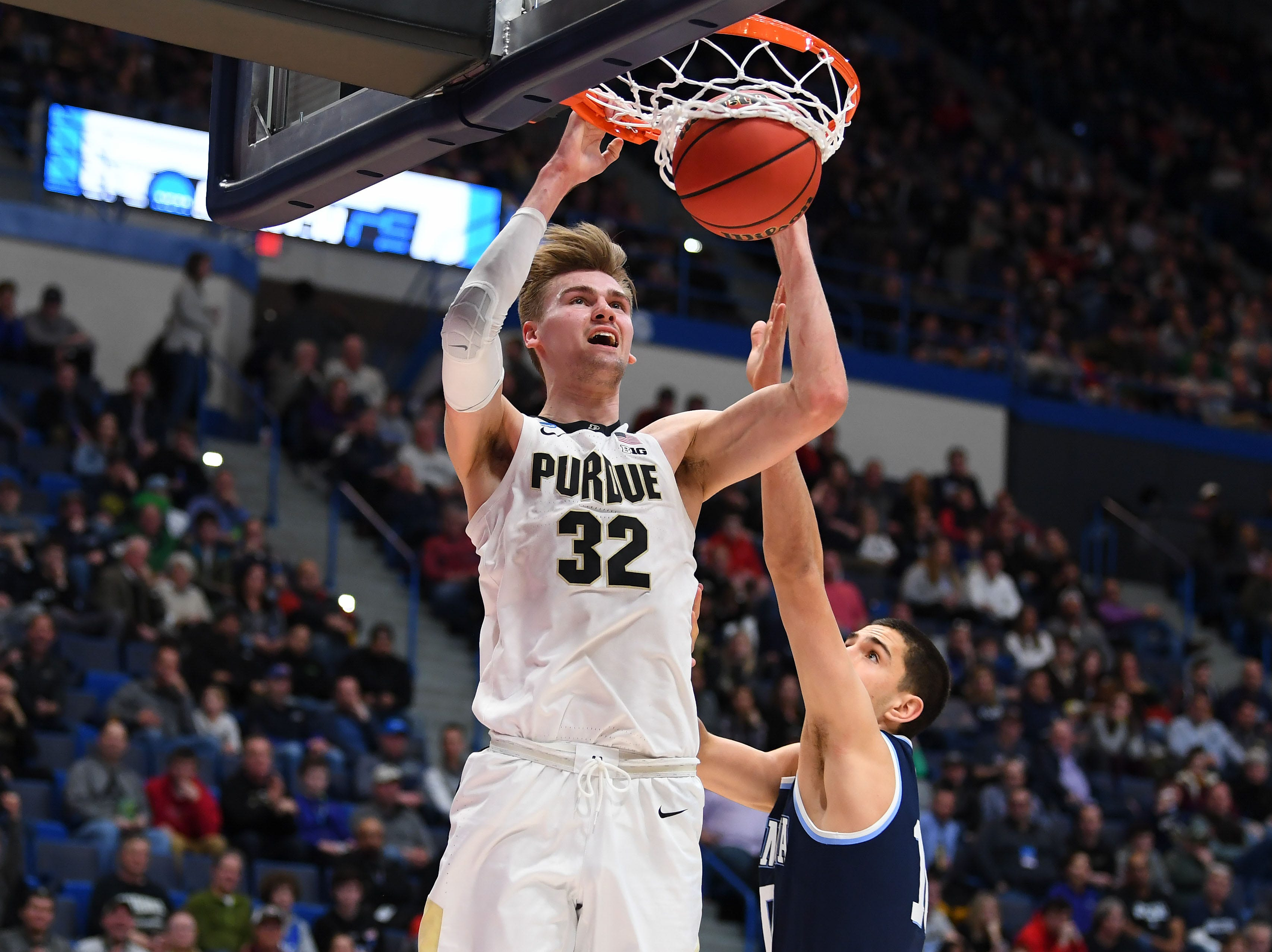 Mar 23, 2019; Hartford, CT, USA; Purdue Boilermakers center Matt Haarms (32) dunks and scores against the Villanova Wildcats during the second half of a game in the second round of the 2019 NCAA Tournament at XL Center. Mandatory Credit: Robert Deutsch-USA TODAY Sports