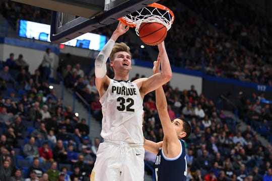 Purdue Boilermakers center Matt Haarms (32) dunks on a Villanova player March 23. He and Tacko Fall (shown in high school in 2015) were two of the 2019 NCAA tournament's tall trees from other countries. Mandatory Credit: Robert Deutsch-USA TODAY Sports