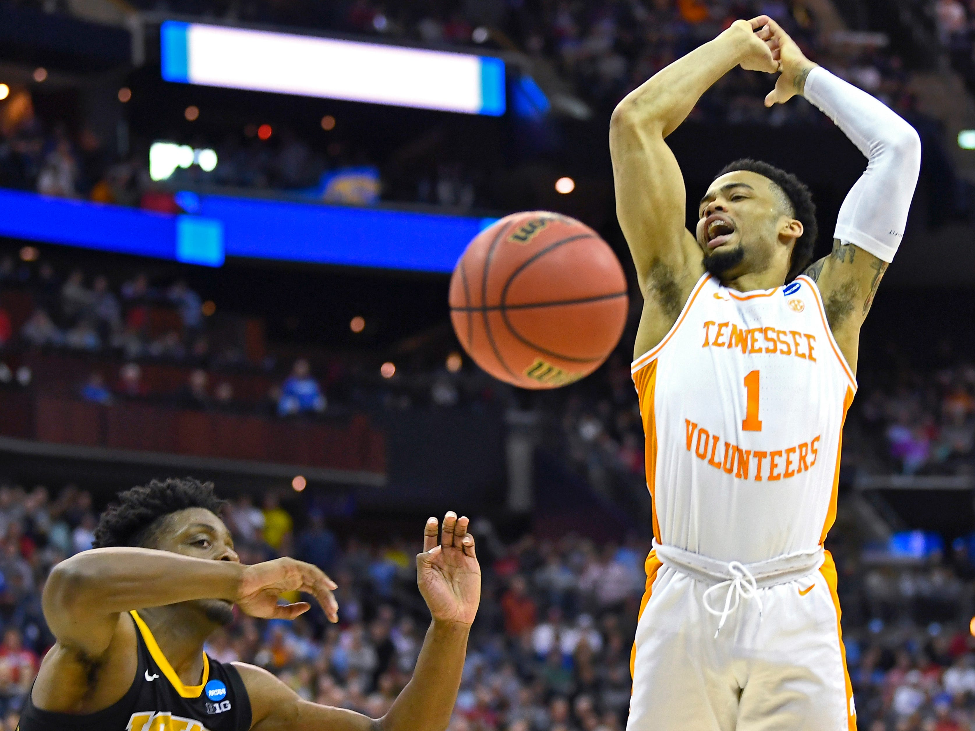 Tennessee guard Lamonte Turner (1) is fouled by Iowa forward Tyler Cook (25) during UT's win overtime win in the second round of the NCAA Tournament at Nationwide Arena in Columbus, Ohio, Sunday, March 24, 2019.