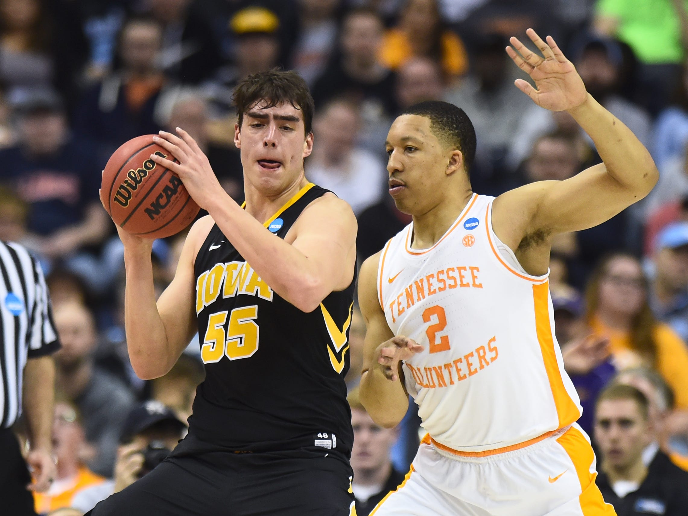 Iowa forward Ryan Kriener (15) tries to move the ball defended by Tennessee forward Grant Williams (2) during the firt half of the second-round game of the NCAA Tournament at Nationwide Arena in Columbus, Ohio, Sunday, March 24, 2019.