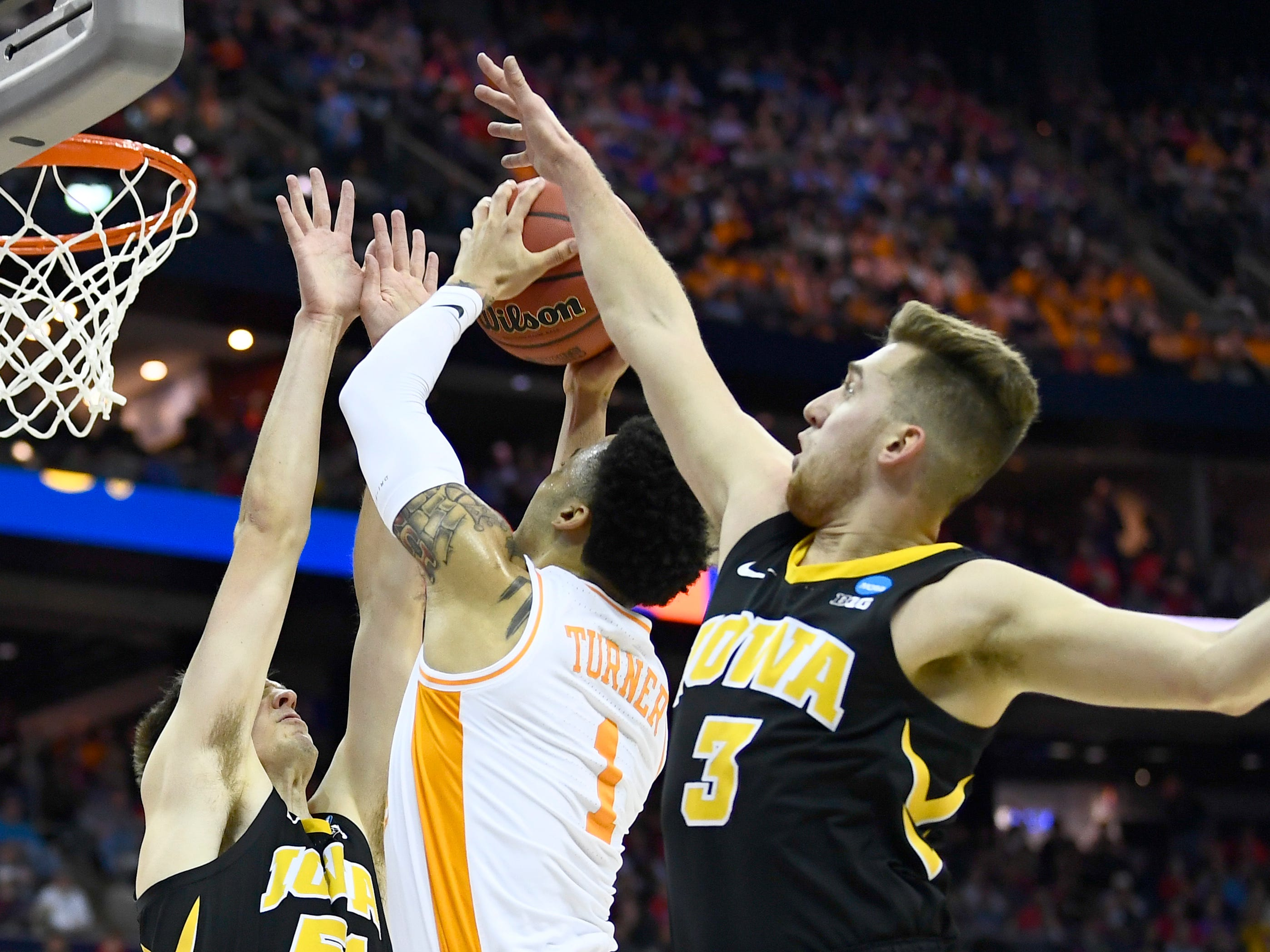 Tennessee guard Lamonte Turner (1) takes a shot between Iowa forward Nicholas Baer (51) and guard Jordan Bohannon (3) during the first half of the game in the second round of the NCAA Tournament at Nationwide Arena in Columbus, Ohio, Sunday, March 24, 2019.
