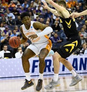 Tennessee guard Admiral Schofield (5) moves the ball defended by Iowa guard Joe Wieskamp (10) during the second half in the second round of the NCAA Tournament at Nationwide Arena in Columbus, Ohio, Sunday, March 24, 2019.