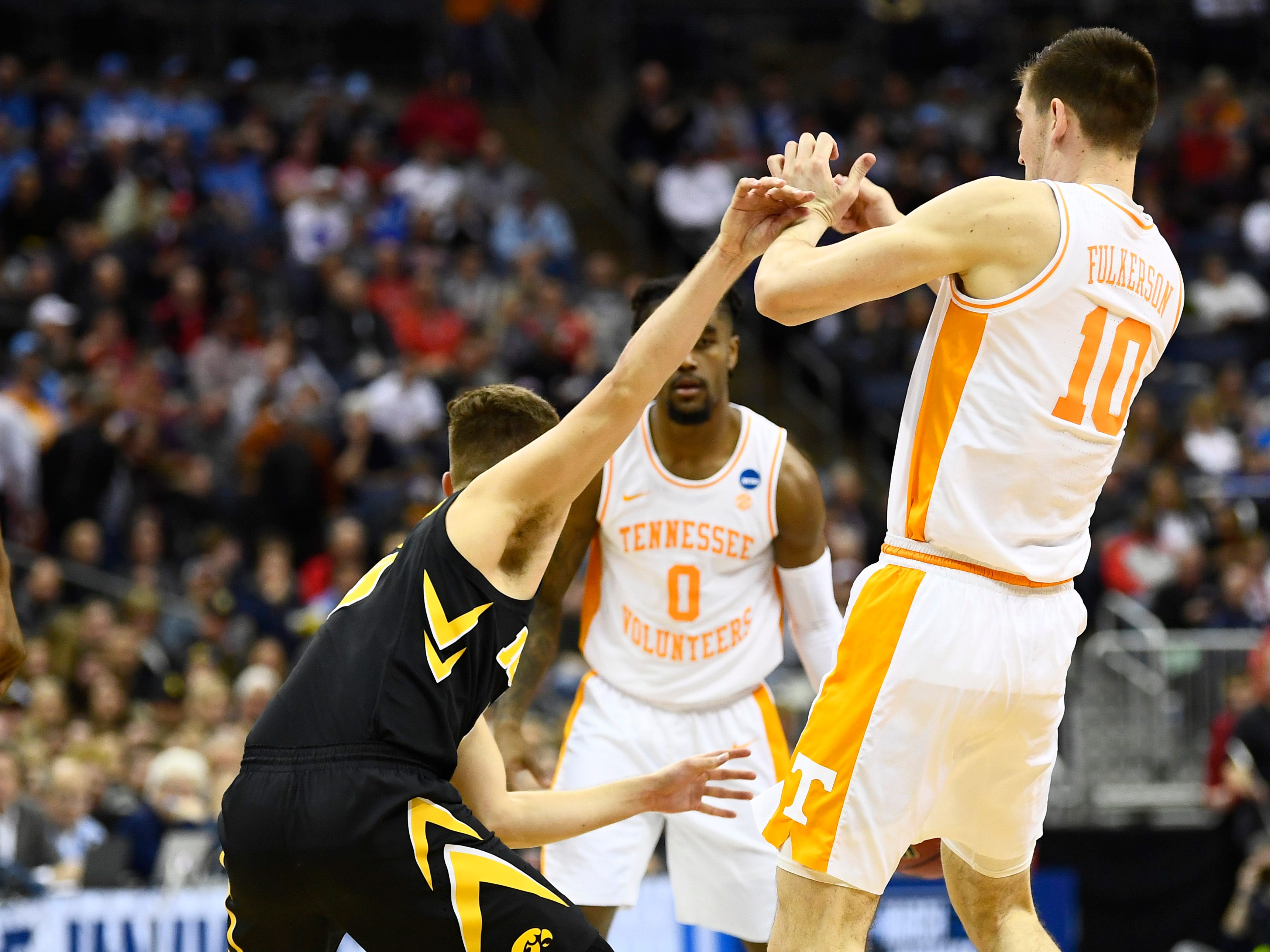 Iowa guard Jordan Bohannon (3) pushes off Tennessee forward John Fulkerson (10) during the second half of the second-round game in the NCAA Tournament at Nationwide Arena in Columbus, Ohio, Sunday, March 24, 2019.