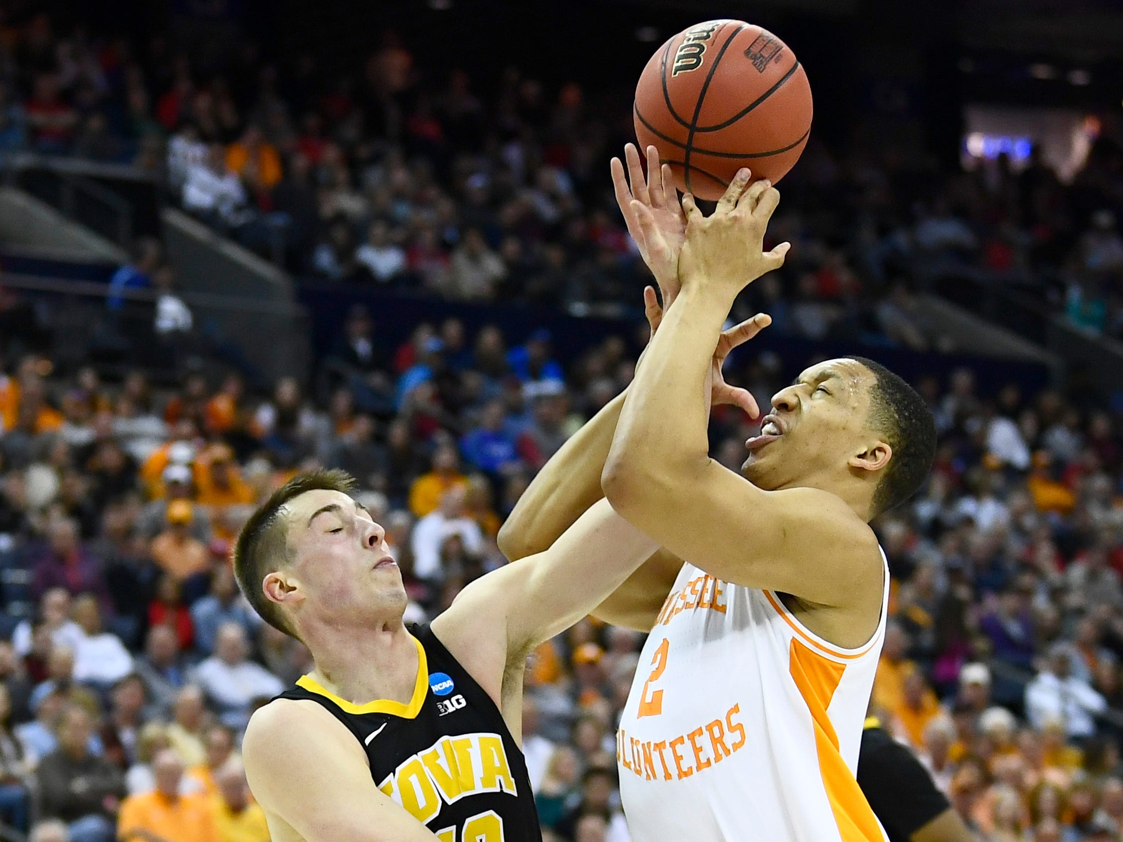Tennessee forward Grant Williams (2) is fouled by Iowa guard Joe Wieskamp (10) during the first half of the game in the second round of the NCAA Tournament at Nationwide Arena in Columbus, Ohio, Sunday, March 24, 2019.